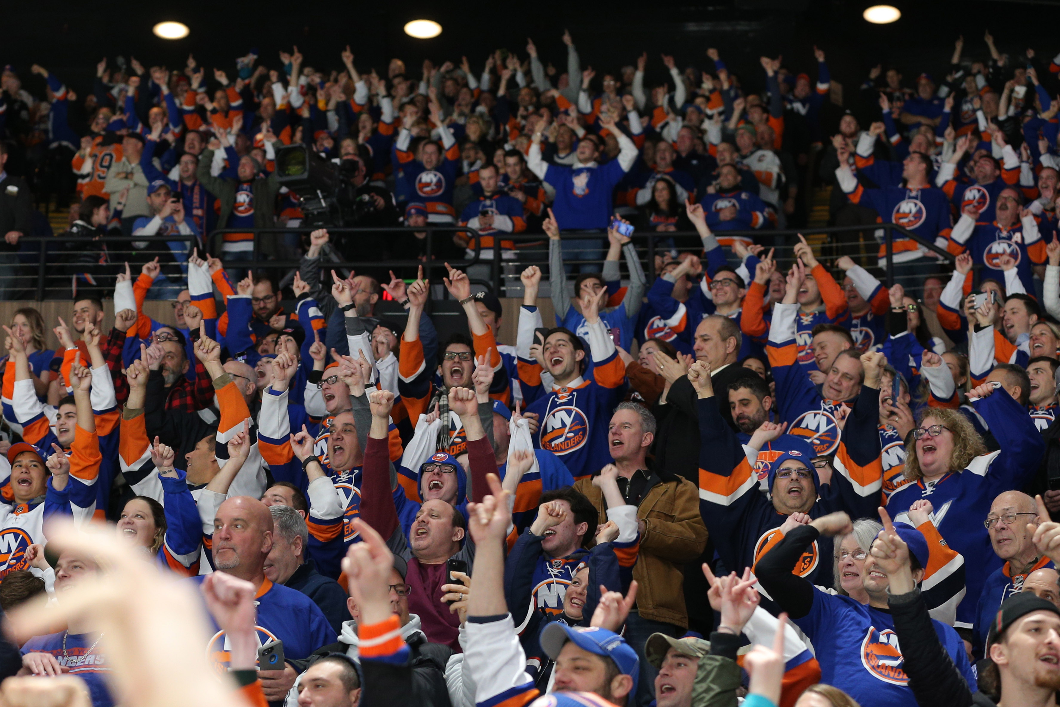 Feb 28, 2019; Brooklyn, NY, USA; New York Islanders fans celebrate a goal against the Toronto Maple Leafs during the second period at the Nassau Veterans Memorial Coliseum. Mandatory Credit: Brad Penner-USA TODAY Sports
