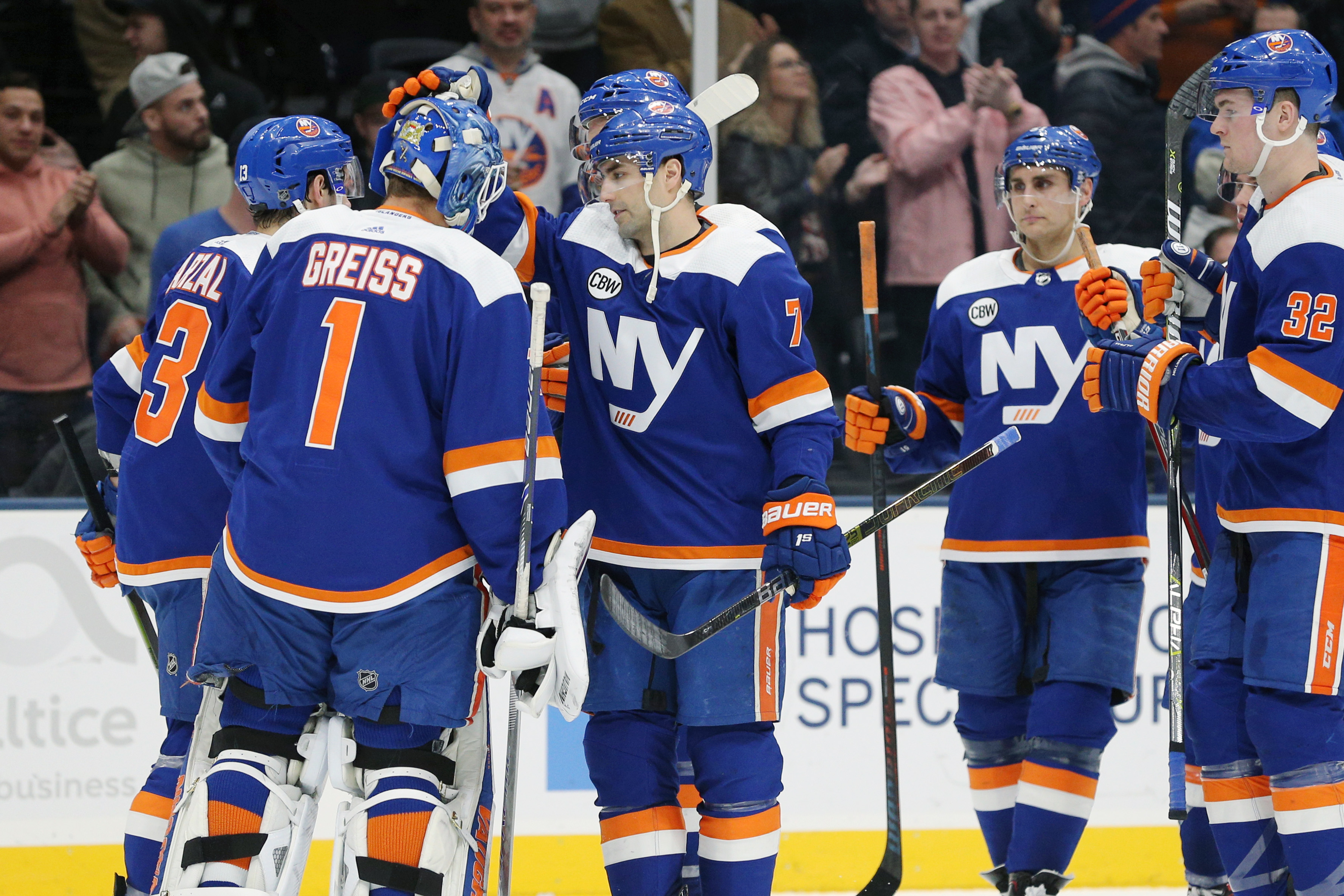 Mar 5, 2019; Uniondale, NY, USA; New York Islanders goalie Thomas Greiss (1) celebrates with teammates after defeating the Ottawa Senators in a shootout at Nassau Veterans Memorial Coliseum. Mandatory Credit: Brad Penner-USA TODAY Sports