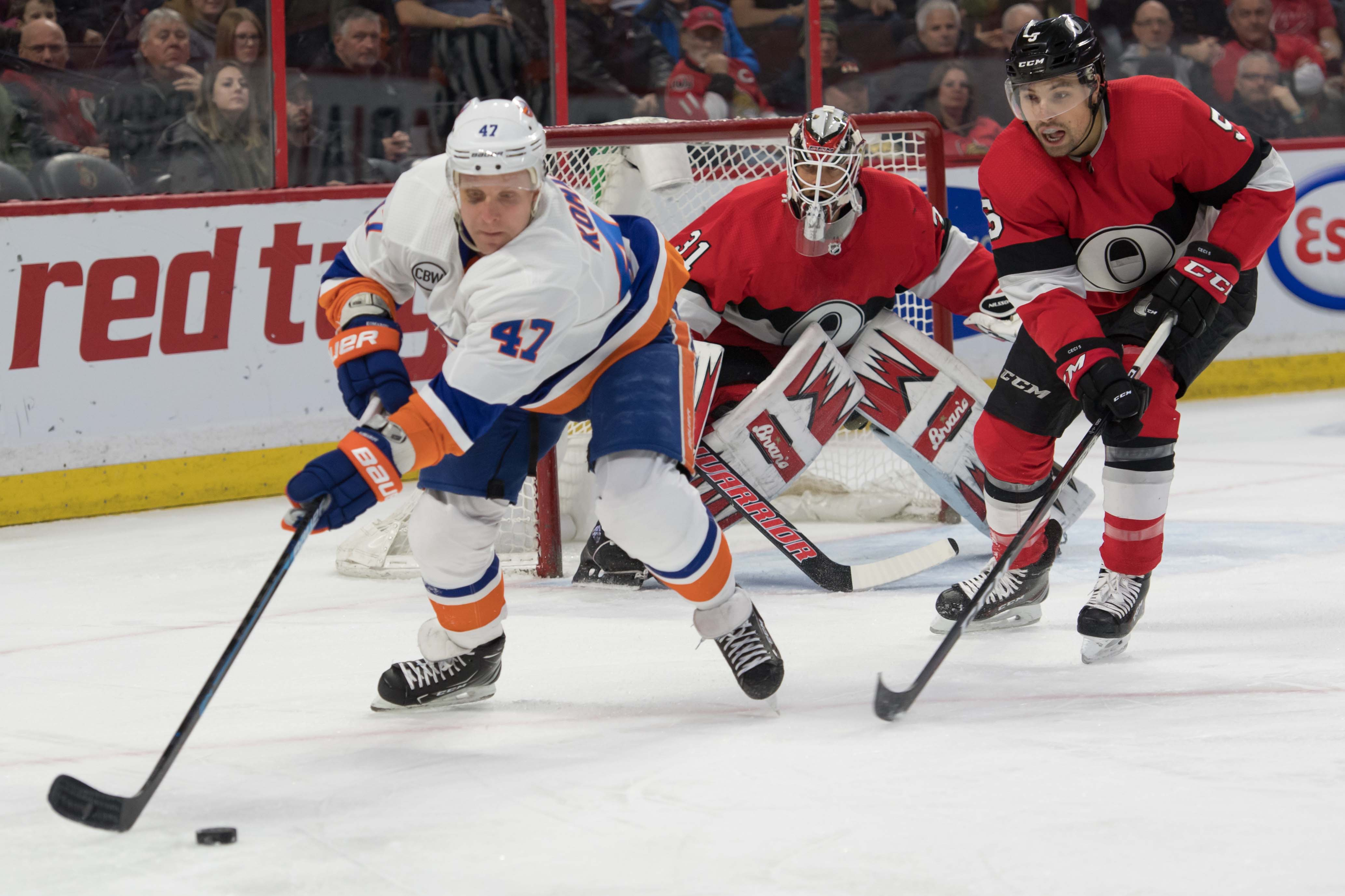 Mar 7, 2019; Ottawa, Ontario, CAN; New York Islanders right wing Leo Komarov (47) skates with the puck in front of Ottawa Senators defenseman Cody Ceci (5) in the first period at the Canadian Tire Centre. Mandatory Credit: Marc DesRosiers-USA TODAY Sports