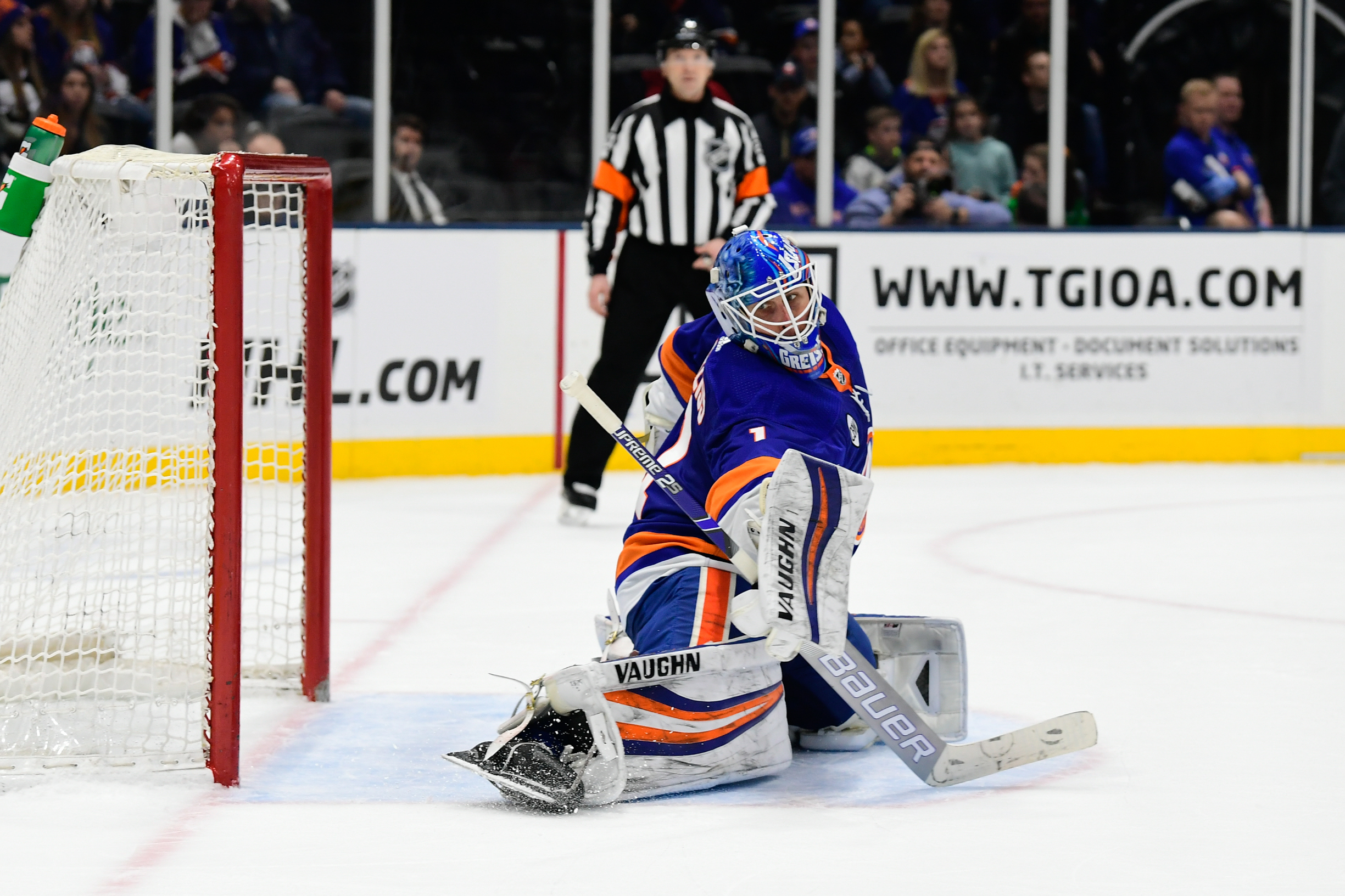 Mar 11, 2019; Uniondale, NY, USA; New York Islanders goalie Thomas Greiss (1) deflects a puck against the Columbus Blue Jackets during the third period at Nassau Veterans Memorial Coliseum. Mandatory Credit: Catalina Fragoso-USA TODAY Sports