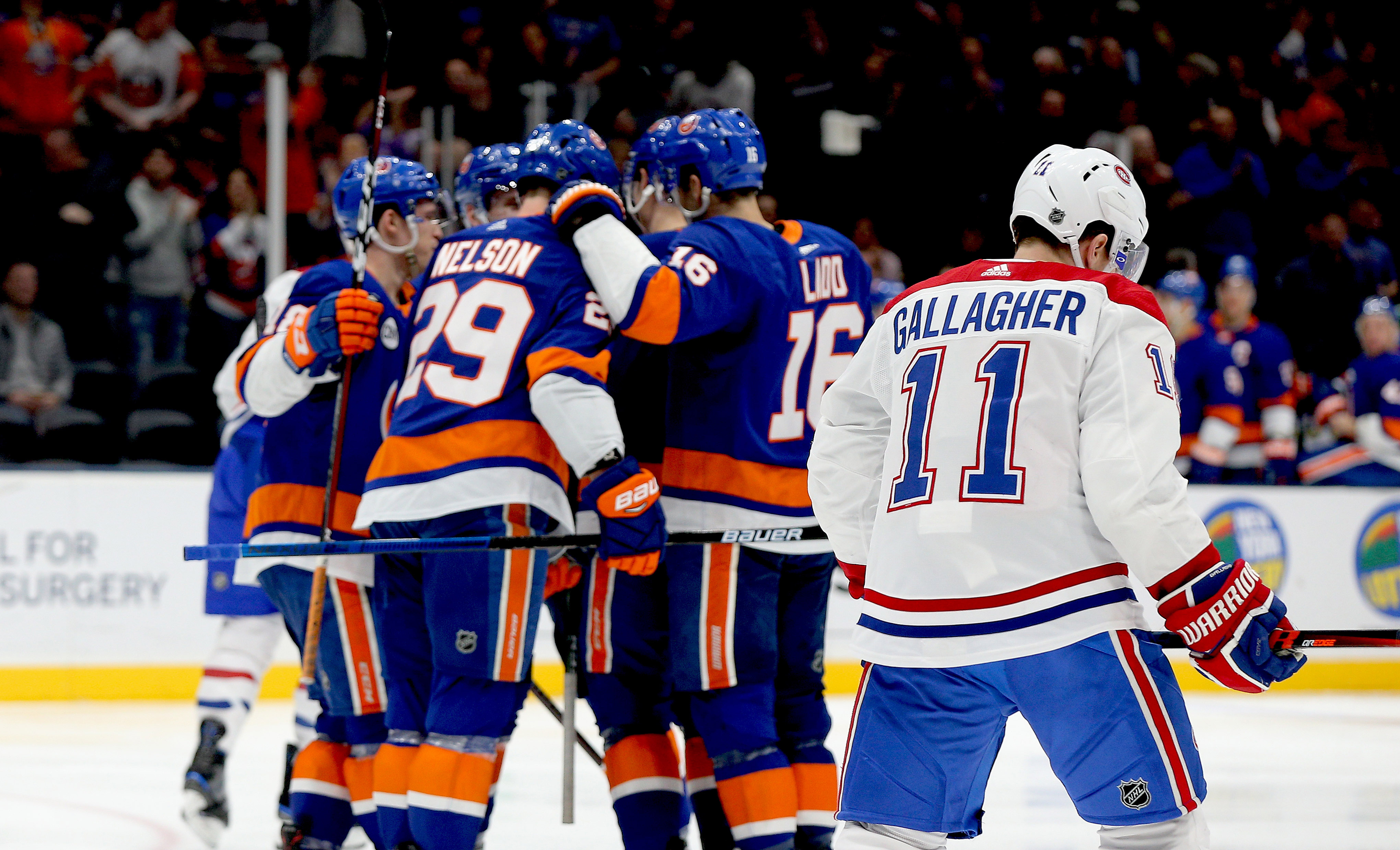 Mar 14, 2019; Uniondale, NY, USA; Montreal Canadiens right wing Brendan Gallagher (11) skates away as the New York Islanders celebrate a goal during the second period at Nassau Veterans Memorial Coliseum. Mandatory Credit: Andy Marlin-USA TODAY Sports