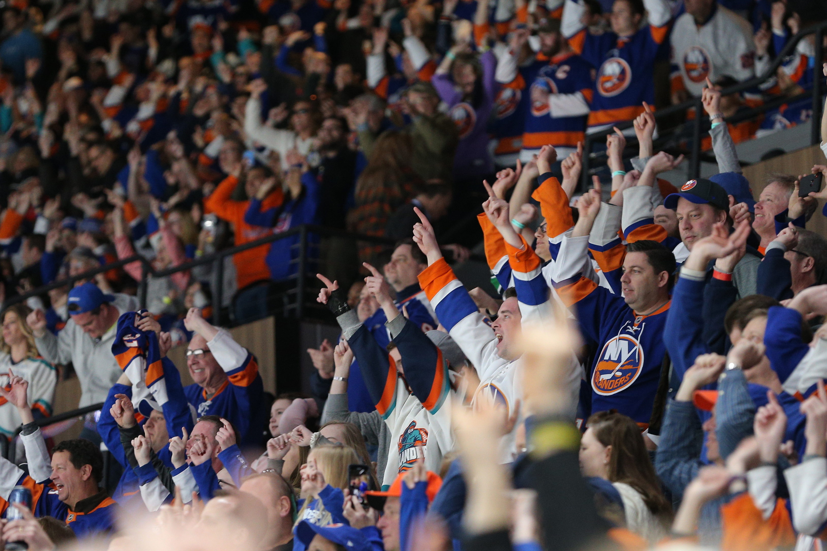 Mar 24, 2019; Uniondale, NY, USA; New York Islanders fans celebrate after an Islanders goal against the Arizona Coyotes during the third period at Nassau Veterans Memorial Coliseum. Mandatory Credit: Brad Penner-USA TODAY Sports