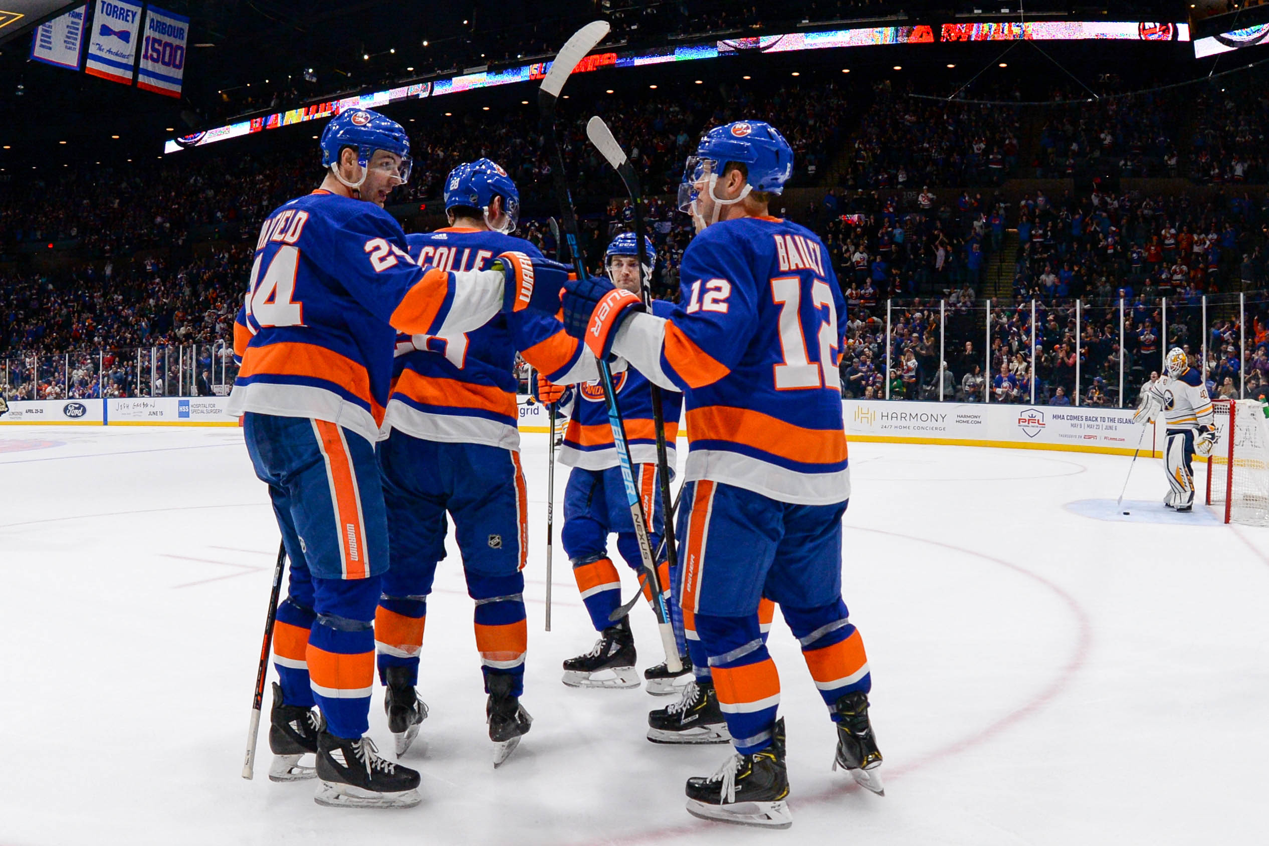 Mar 30, 2019; Uniondale, NY, USA; New York Islanders celebrate the goal by left wing Michael Dal Colle (28) against the Buffalo Sabres during the second period at Nassau Veterans Memorial Coliseum. Mandatory Credit: Dennis Schneidler-USA TODAY Sports