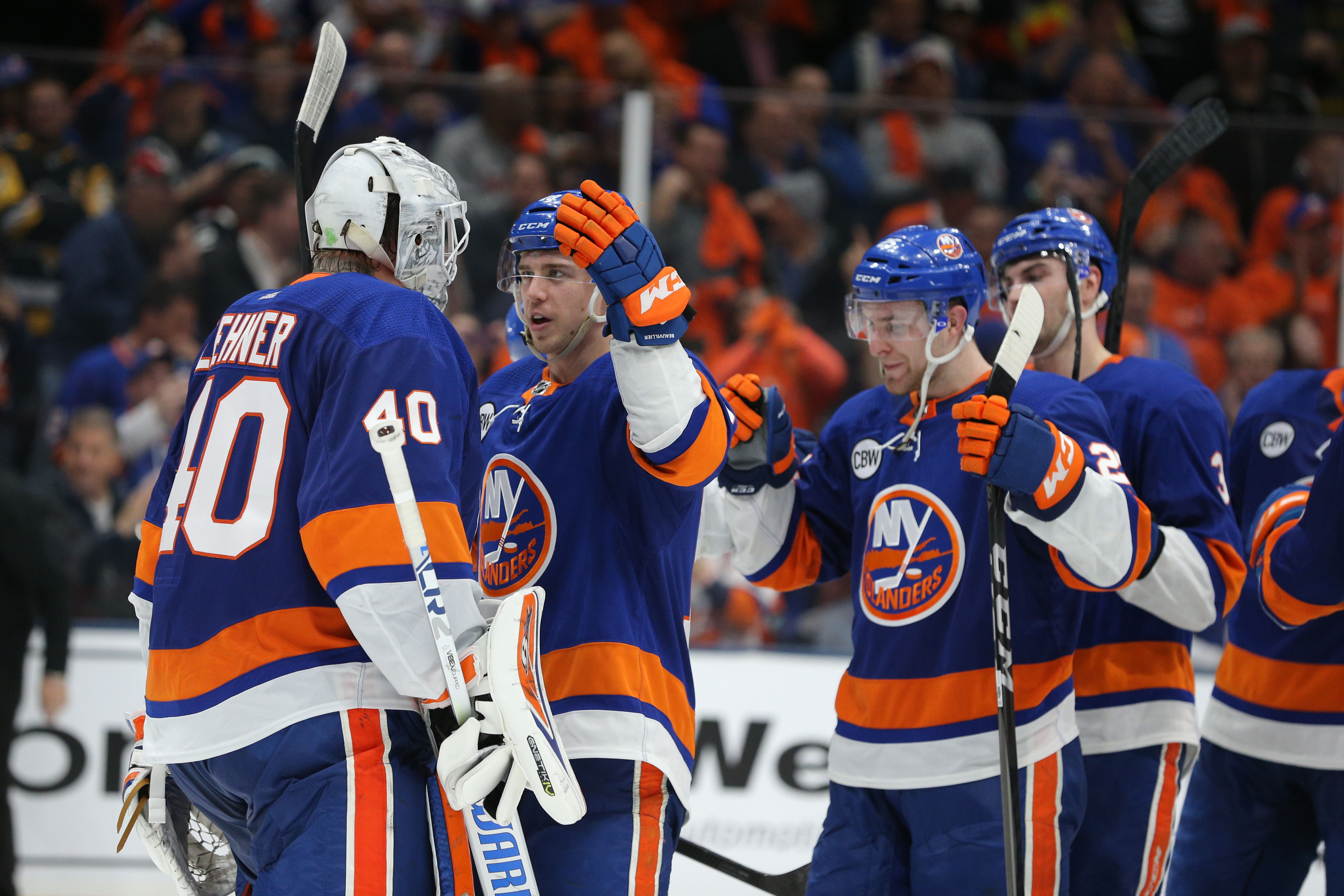 Apr 12, 2019; Uniondale, NY, USA; New York Islanders left wing Anthony Beauvillier (18) celebrates with goalie Robin Lehner (40) after defeating the Pittsburgh Penguins in game two of the first round of the 2019 Stanley Cup Playoffs at Nassau Veterans Memorial Coliseum. Mandatory Credit: Brad Penner-USA TODAY Sports