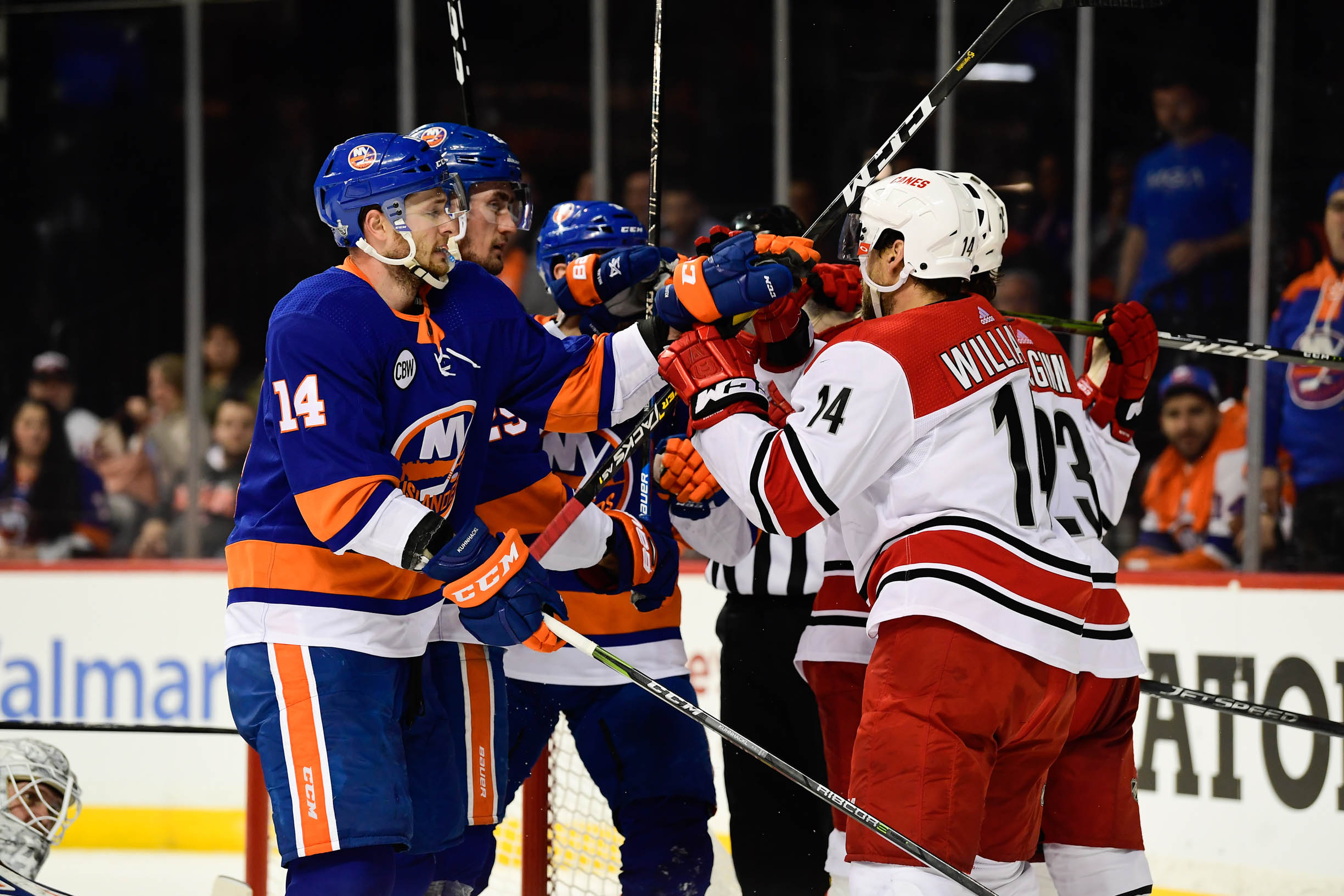 Apr 26, 2019; Brooklyn, NY, USA; New York Islanders right wing Tom Kuhnhackl (14) and Carolina Hurricanes right wing Justin Williams (14) scuffle during the first period in game one of the second round of the 2019 Stanley Cup Playoffs at Barclays Center. Mandatory Credit: Catalina Fragoso-USA TODAY Sports