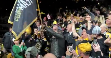 Bill Belichick fires up Bruins fans waving flag before Game 2 (Video)