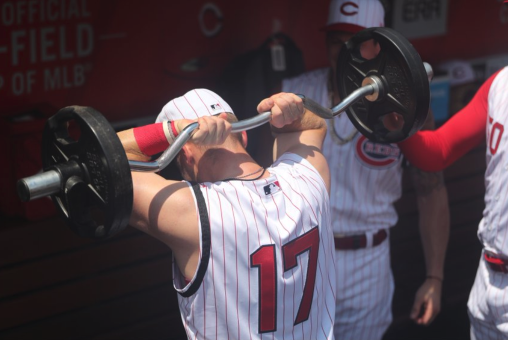 Look: Reds have a blast in dugout rocking throwback sleeveless uniforms
