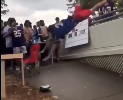 Bills fan goes flying headfirst into table on tailgate fail (Video)