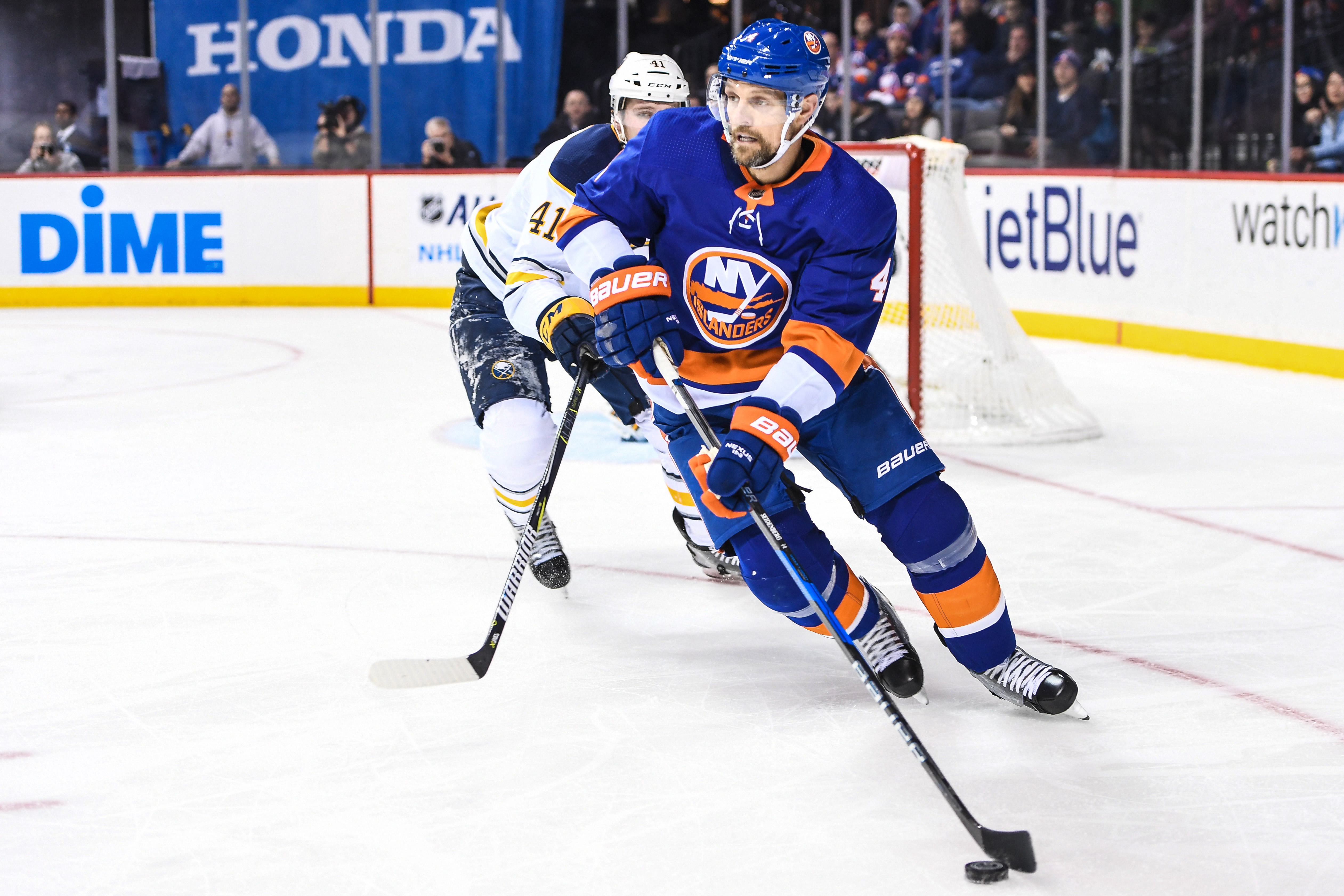 Dec 27, 2017; Brooklyn, NY, USA; New York Islanders defenseman Dennis Seidenberg (4) looks to make a pass defended by Buffalo Sabres defenseman Justin Falk (41) during the second period go the game between the New York Islanders and the Buffalo Sabres at Barclays Center. Mandatory Credit: Dennis Schneidler-USA TODAY Sports