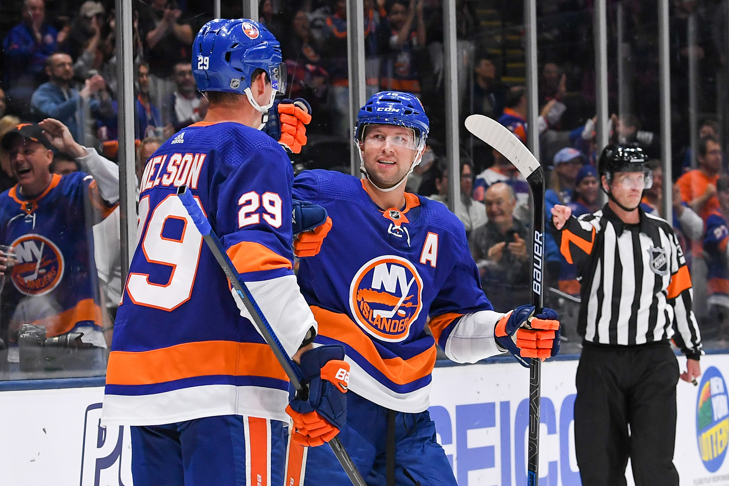 Oct 6, 2019; Brooklyn, NY, USA; New York Islanders celebrate the goal by New York Islanders center Brock Nelson (29) against the Winnipeg Jets during the second period at Nassau Veterans Memorial Coliseum. Mandatory Credit: Dennis Schneidler-USA TODAY Sports