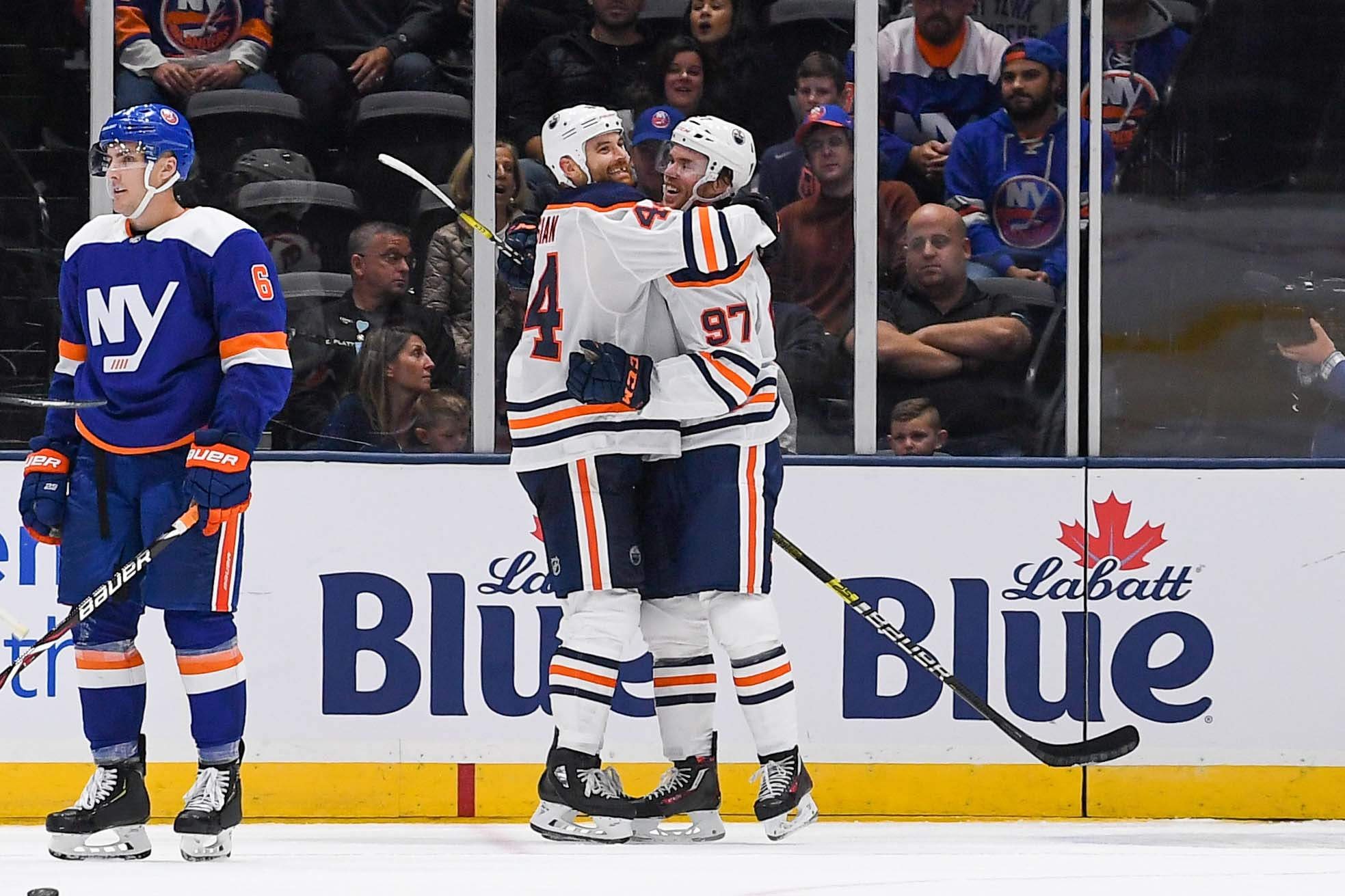 Oct 8, 2019; Uniondale, NY, USA; Edmonton Oilers right wing Zack Kassian (44) celebrates his goal with Edmonton Oilers center Connor McDavid (97) against the New York Islanders during the second period at Nassau Veterans Memorial Coliseum. Mandatory Credit: Dennis Schneidler-USA TODAY Sports