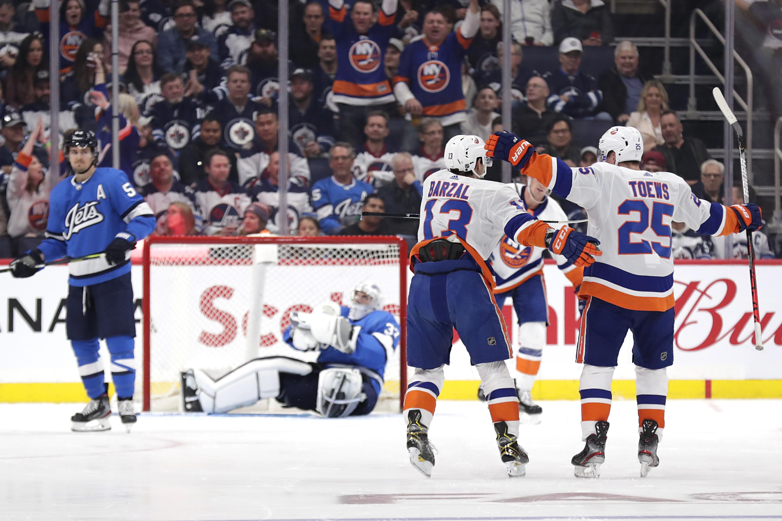 Oct 17, 2019; Winnipeg, Manitoba, CAN; New York Islanders center Mathew Barzal (13) celebrates his second period goal against the Winnipeg Jets at Bell MTS Place. Mandatory Credit: James Carey Lauder-USA TODAY Sports