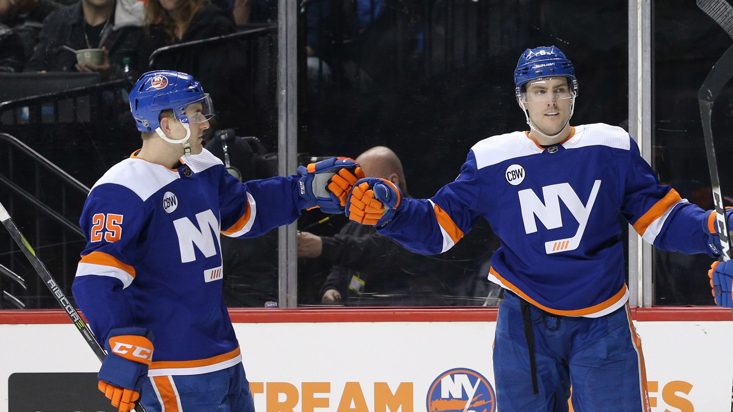 Feb 16, 2019; Brooklyn, NY, USA; New York Islanders defenseman Ryan Pulock (6) celebrates his goal against the Edmonton Oilers with defenseman Devon Toews (25) and left wing Anthony Beauvillier (18) during the second period at Barclays Center. Mandatory Credit: Brad Penner-USA TODAY Sports