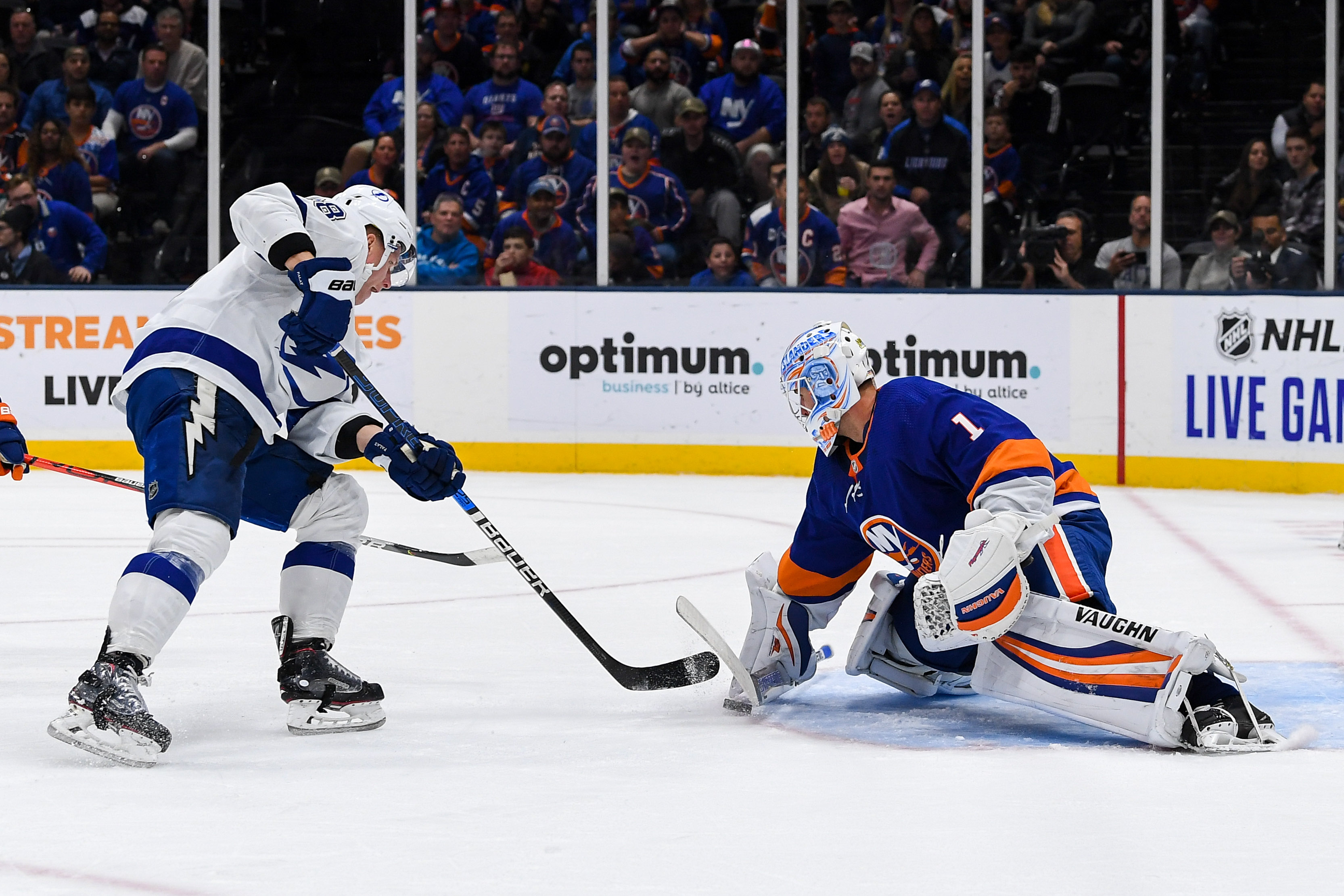 Nov 1, 2019; Uniondale, NY, USA; New York Islanders goaltender Thomas Greiss (1) makes a save on Tampa Bay Lightning left wing Ondrej Palat (18) during the first period at Nassau Veterans Memorial Coliseum. Mandatory Credit: Dennis Schneidler-USA TODAY Sports