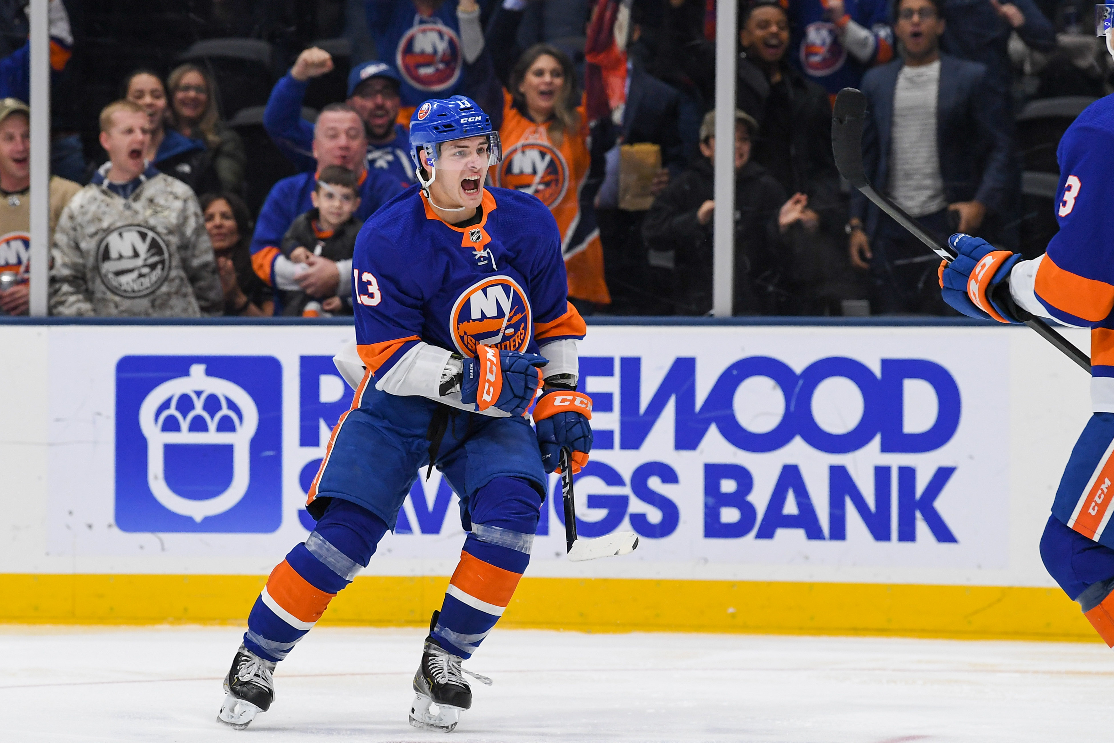 Nov 1, 2019; Uniondale, NY, USA; New York Islanders center Mathew Barzal (13) celebrates his goal against the Tampa Bay Lightning during the second period at Nassau Veterans Memorial Coliseum. Mandatory Credit: Dennis Schneidler-USA TODAY Sports