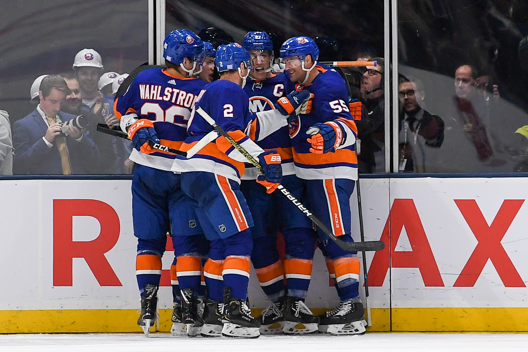 Nov 1, 2019; Uniondale, NY, USA; New York Islanders celebrate the goal by New York Islanders center Anders Lee (27) against the Tampa Bay Lightning during the third period at Nassau Veterans Memorial Coliseum. Mandatory Credit: Dennis Schneidler-USA TODAY Sports