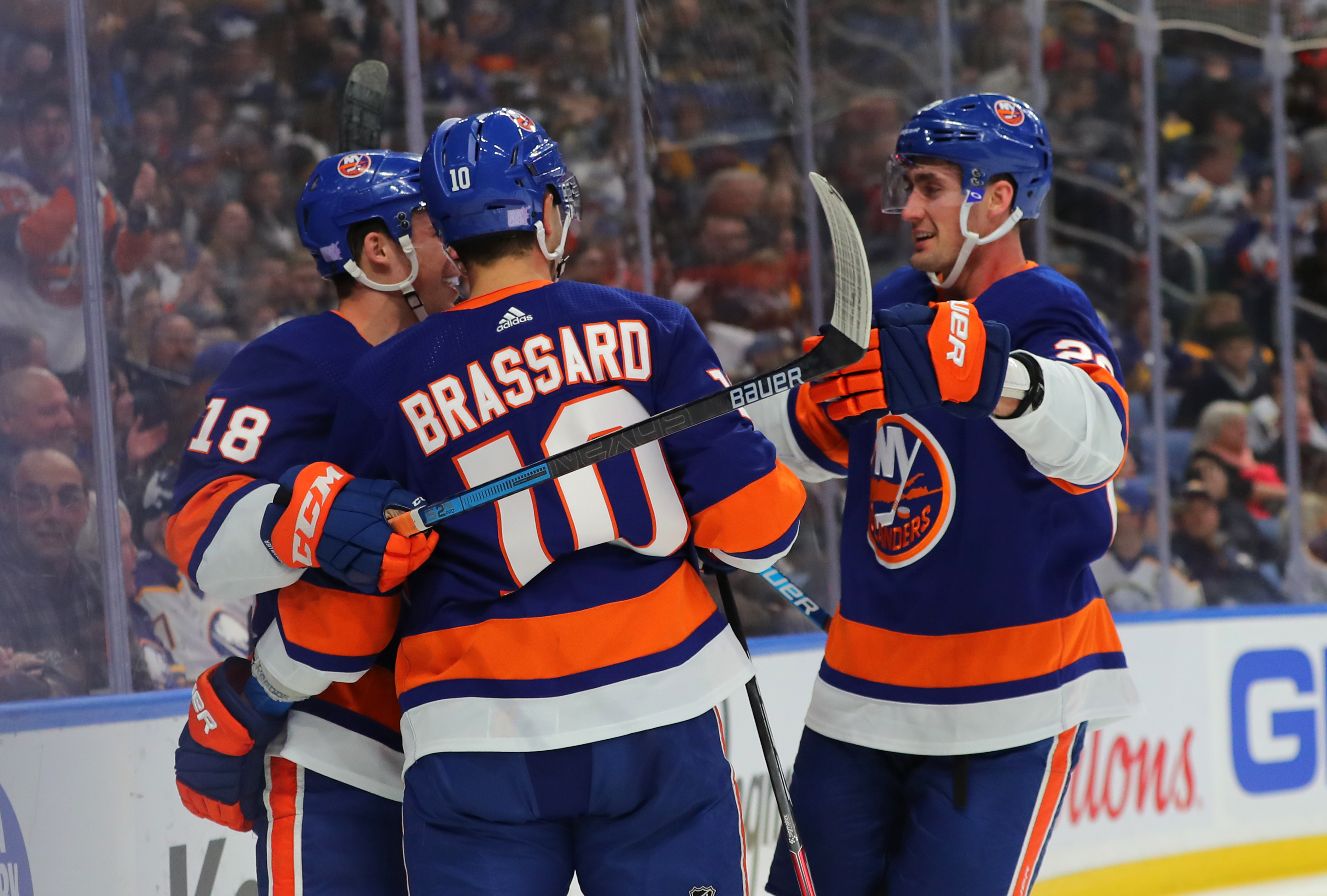 Nov 2, 2019; Buffalo, NY, USA; New York Islanders center Derick Brassard (10) celebrates with teammates after scoring a goal during the first period against the Buffalo Sabres at KeyBank Center. Mandatory Credit: Timothy T. Ludwig-USA TODAY Sports