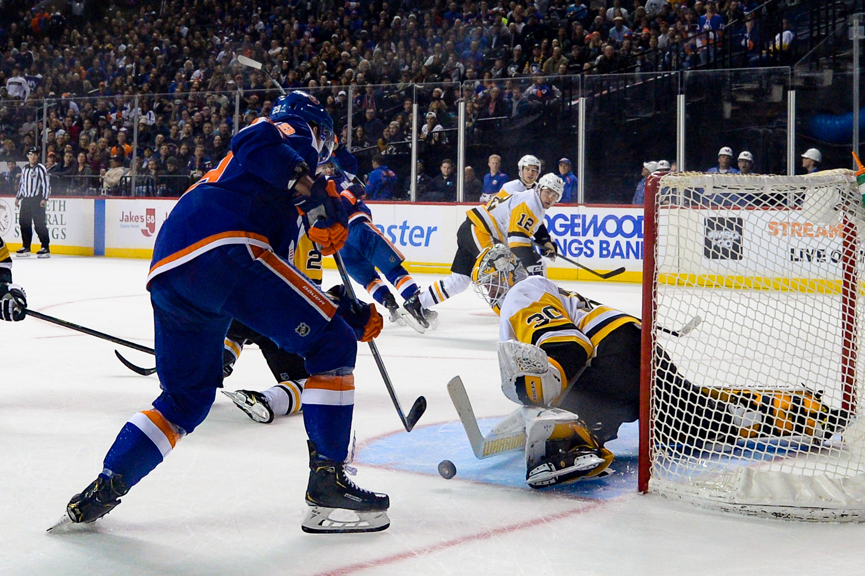 Nov 7, 2019; Brooklyn, NY, USA; Pittsburgh Penguins goaltender Matt Murray (30) makes a save against New York Islanders center Brock Nelson (29) during the second period at Barclays Center. Mandatory Credit: Dennis Schneidler-USA TODAY Sports