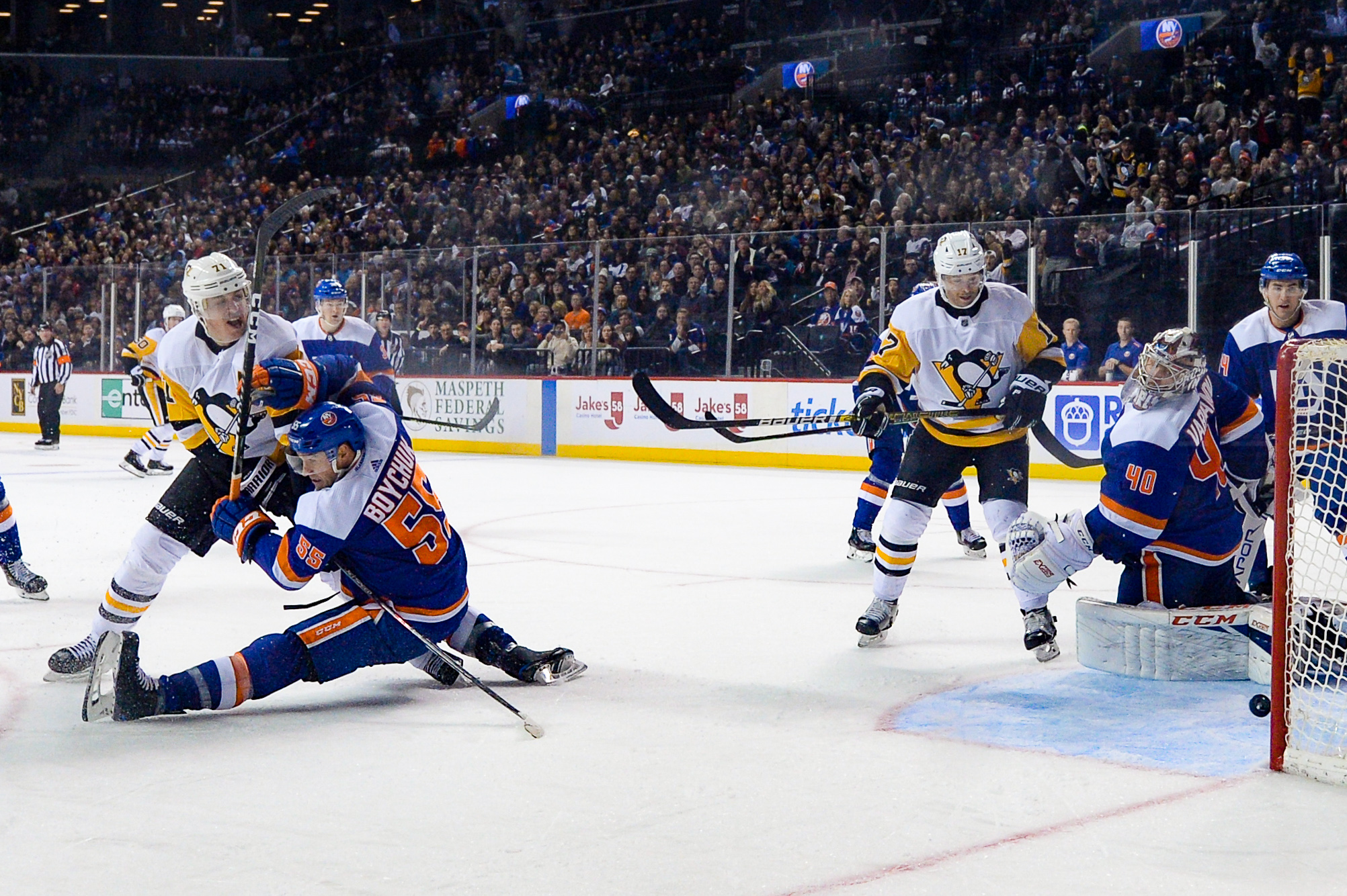 Nov 7, 2019; Brooklyn, NY, USA; Pittsburgh Penguins center Evgeni Malkin (71) scores a goal against New York Islanders defenseman Johnny Boychuk (55) during the third period at Barclays Center. Mandatory Credit: Dennis Schneidler-USA TODAY Sports