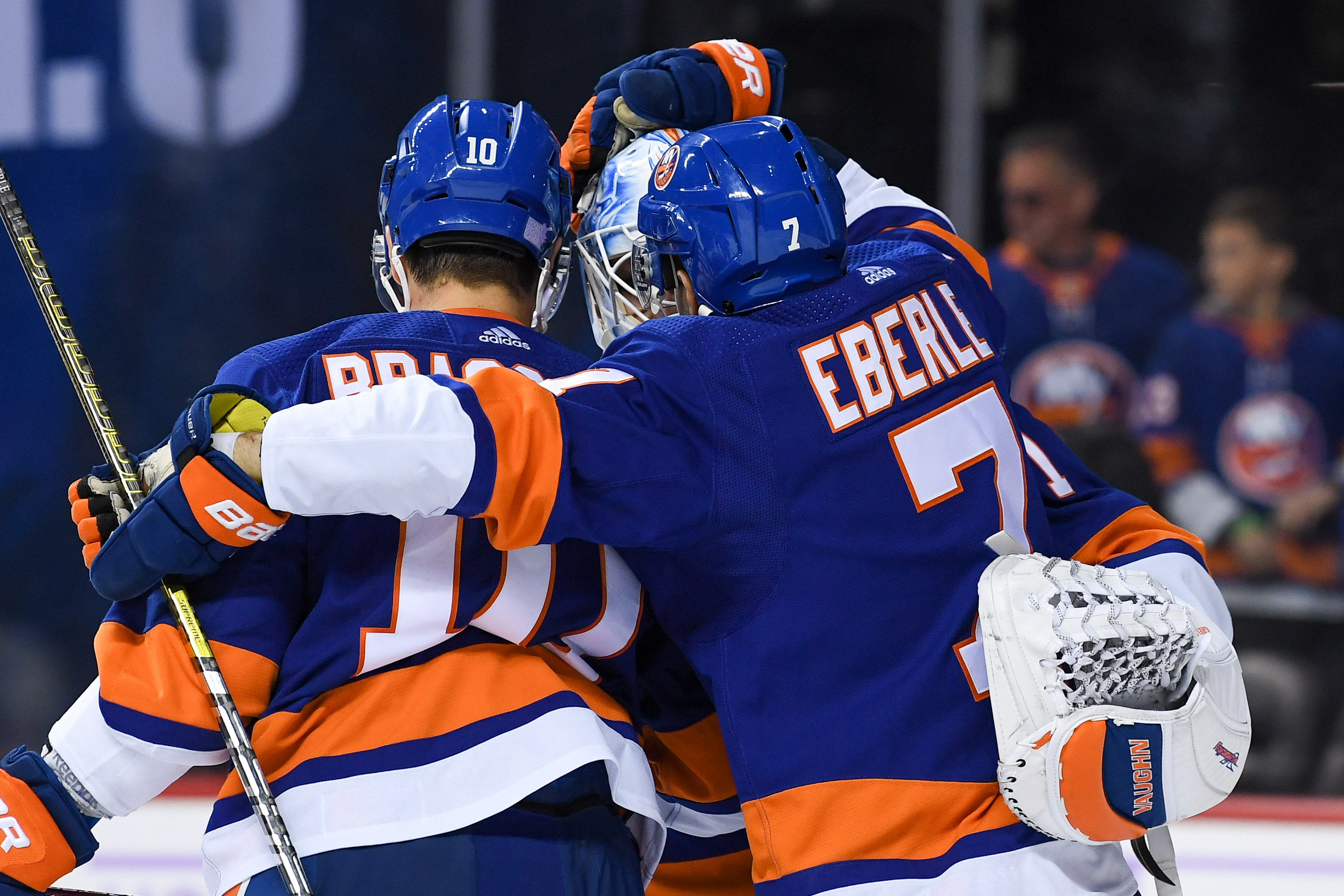 Nov 9, 2019; Brooklyn, NY, USA; New York Islanders center Jordan Eberle (7) and center Derick Brassard (10) congratulate goaltender Thomas Greiss (1) after a 2-1 victory over the Florida Panthers at Barclays Center. Mandatory Credit: Dennis Schneidler-USA TODAY Sports