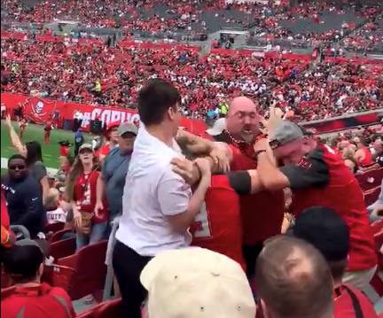 Bucs fans fight in stands, woman gets put in chokehold (Video)