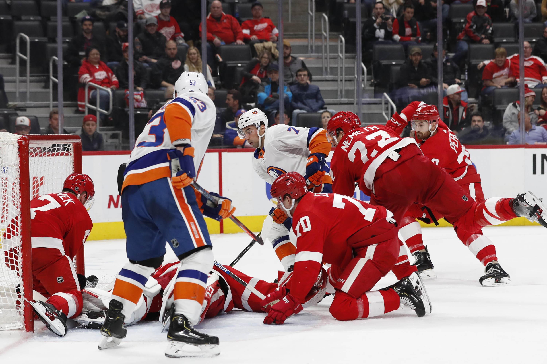 Dec 2, 2019; Detroit, MI, USA; New York Islanders center Jordan Eberle (7) scores a goal on Detroit Red Wings goaltender Jonathan Bernier (45) in the third period at Little Caesars Arena. Mandatory Credit: Rick Osentoski-USA TODAY Sports