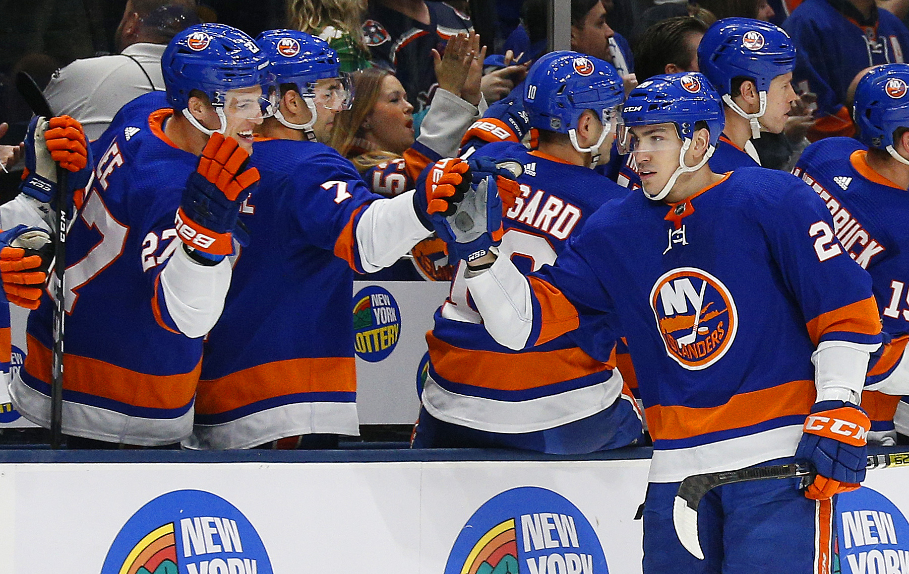 Dec 14, 2019; Uniondale, NY, USA; New York Islanders left wing Michael Dal Colle (28) celebrates with teammates after scoring a goal against the Buffalo Sabres during the first period at Nassau Veterans Memorial Coliseum. Mandatory Credit: Andy Marlin-USA TODAY Sports