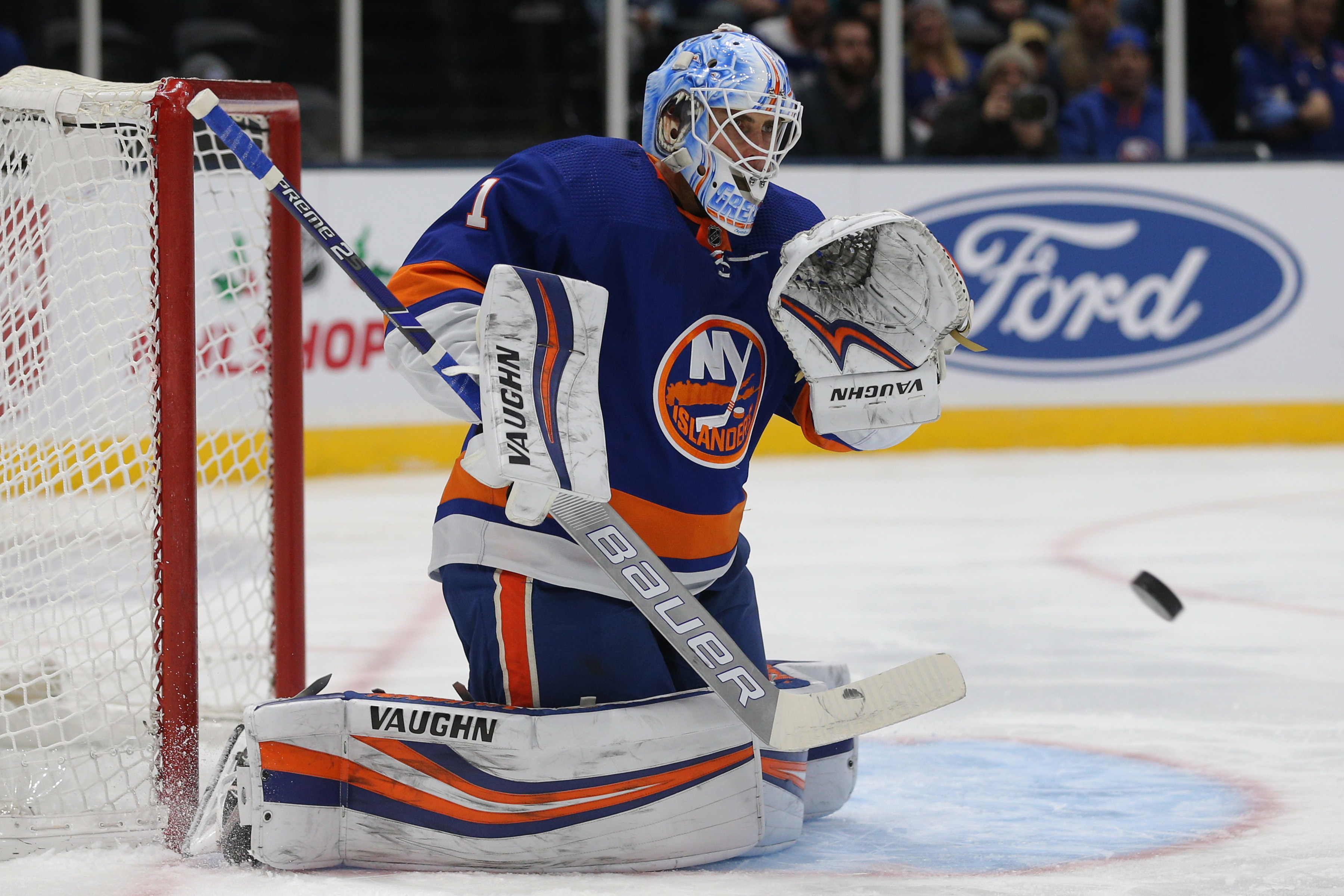 Dec 17, 2019; Uniondale, NY, USA; New York Islanders goalie Thomas Greiss (1) plays the puck against the Nashville Predators during the first period at Nassau Veterans Memorial Coliseum. Mandatory Credit: Brad Penner-USA TODAY Sports