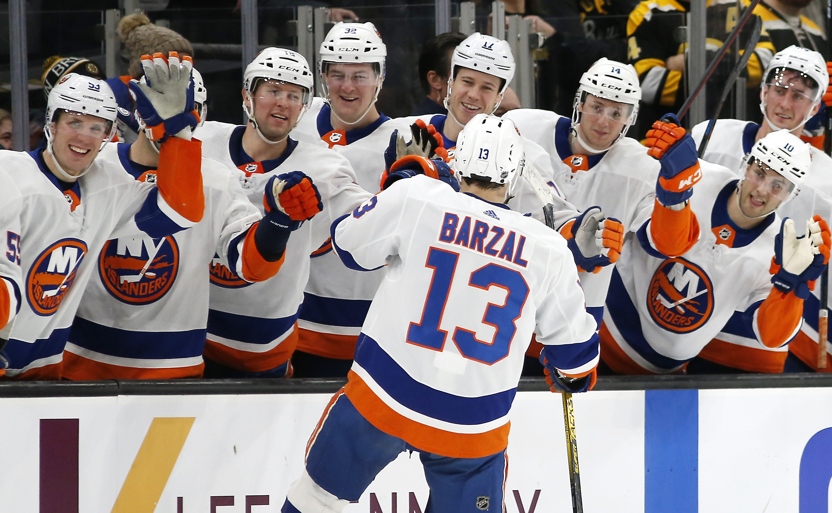 Dec 19, 2019; Boston, MA, USA; New York Islanders center Mathew Barzal (13) celebrates with teammates after scoring a goal against the Boston Bruins during a shootout at TD Garden. Mandatory Credit: Winslow Townson-USA TODAY Sports