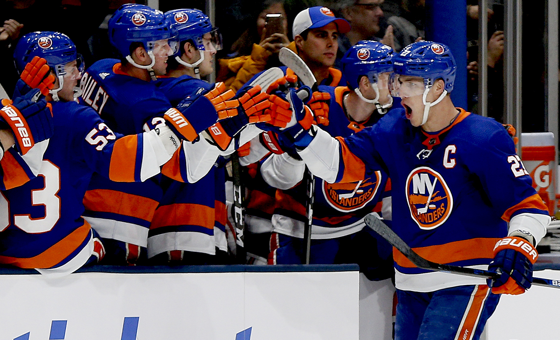 Jan 6, 2020; Brooklyn, New York, USA; New York Islanders left wing Anders Lee (27) is congratulated after scoring the game winning goal against the Colorado Avalanche at NYCB Live in Uniondale New York.. Mandatory Credit: Andy Marlin-USA TODAY Sports