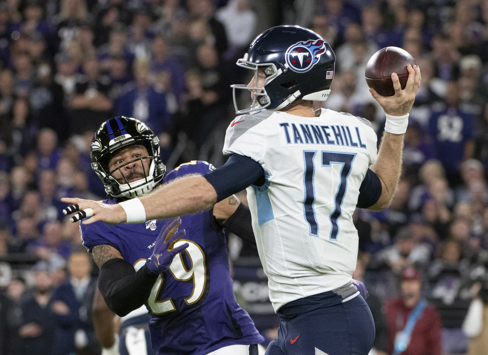 Ravens' turbulent flight continues in loss to Titans, 30-24