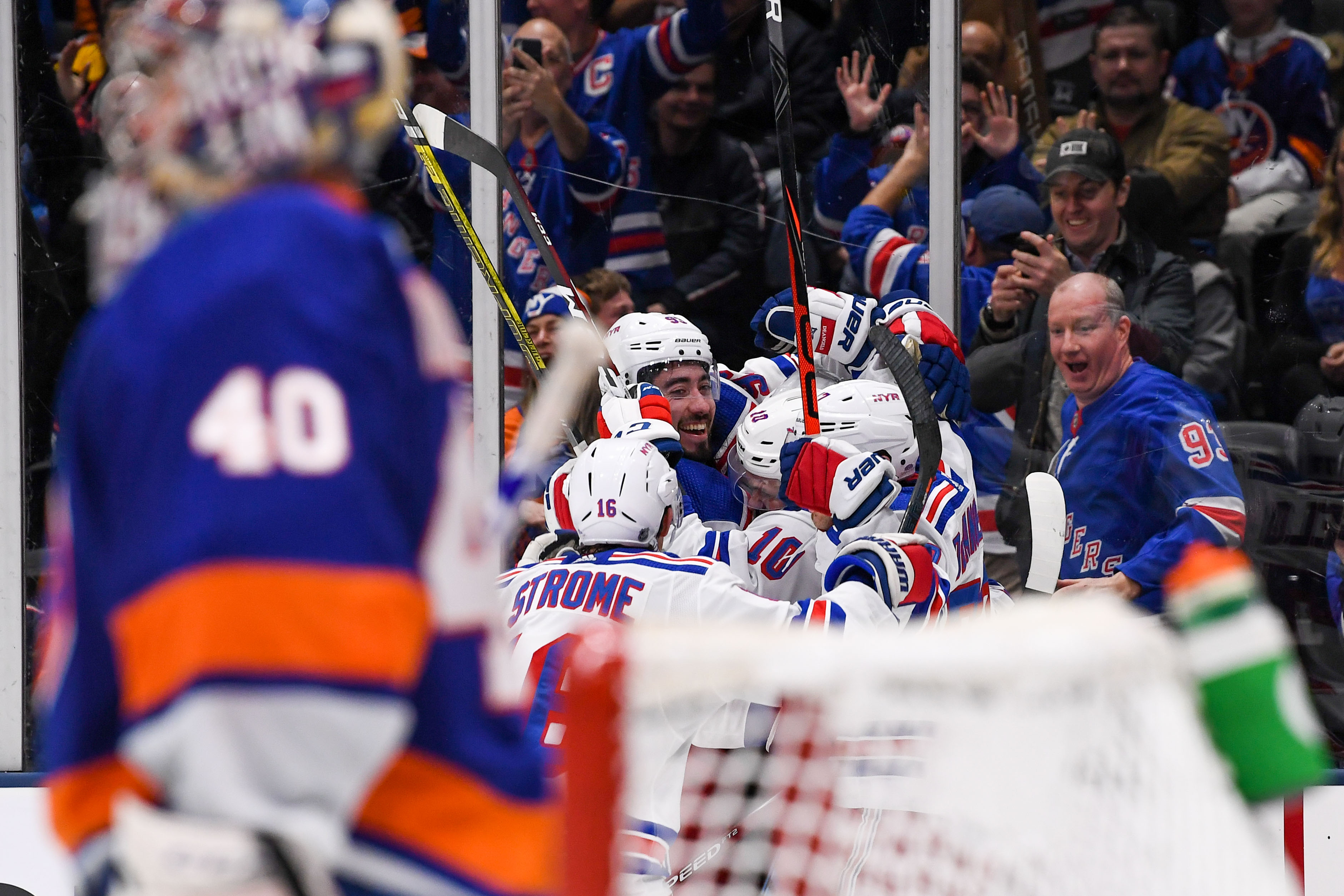 Jan 16, 2020; Uniondale, New York, USA; New York Rangers celebrate after scoring the winning goal against the New York Islanders during the third period at Nassau Veterans Memorial Coliseum. Mandatory Credit: Dennis Schneidler-USA TODAY Sports