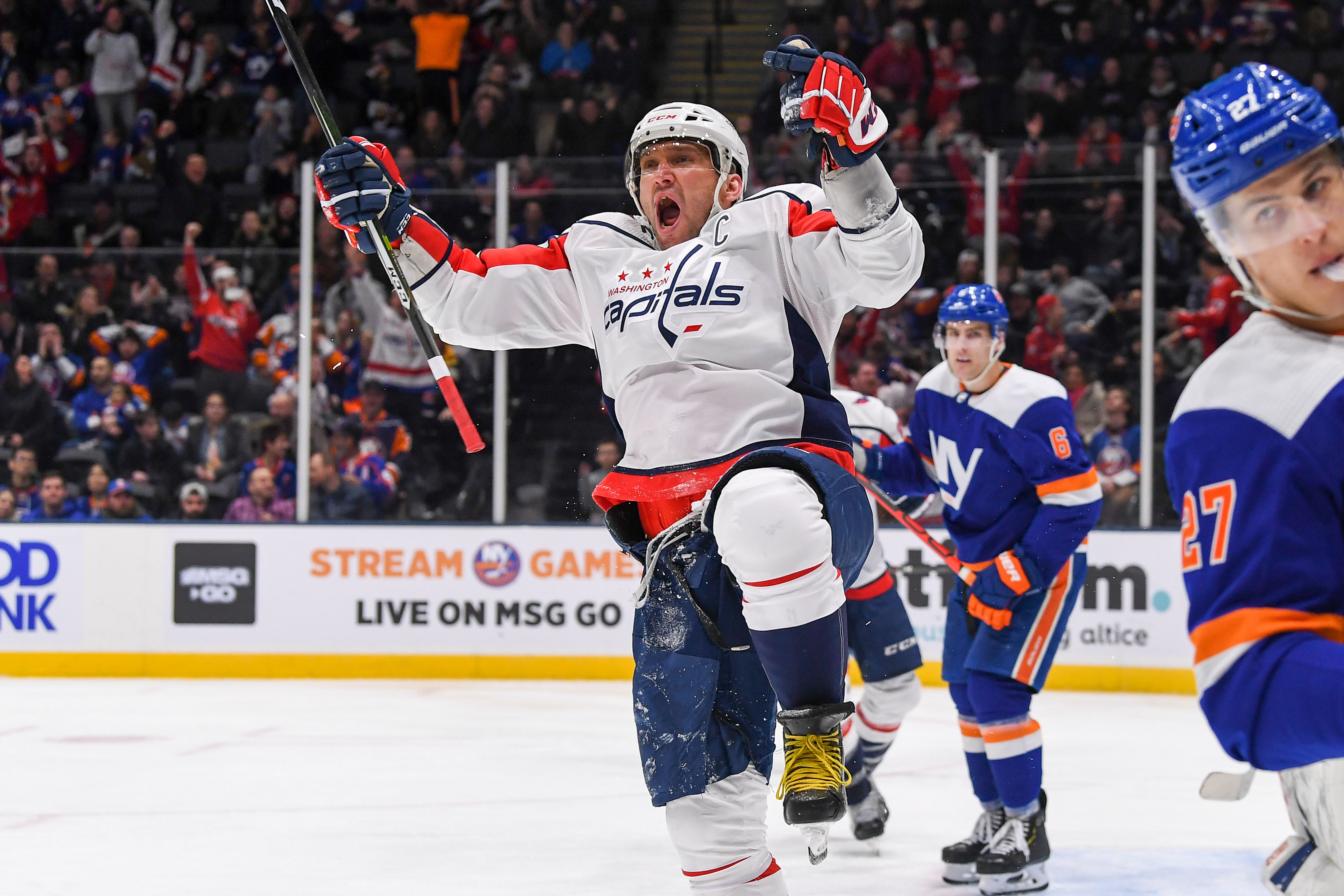 Jan 18, 2020; Uniondale, New York, USA; Washington Capitals left wing Alex Ovechkin (8) celebrate after scoring a goal against the New York Islanders during the third period at Nassau Veterans Memorial Coliseum. Mandatory Credit: Dennis Schneidler-USA TODAY Sports