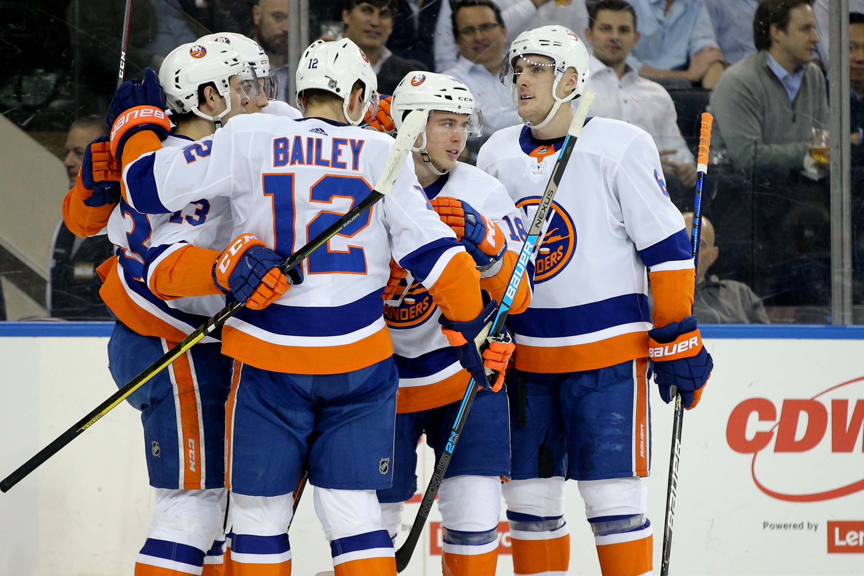 Jan 21, 2020; New York, New York, USA; New York Islanders left wing Anthony Beauvillier (18) celebrates with teammates after scoring a power play goal against the New York Rangers during the first period at Madison Square Garden. Mandatory Credit: Brad Penner-USA TODAY Sports