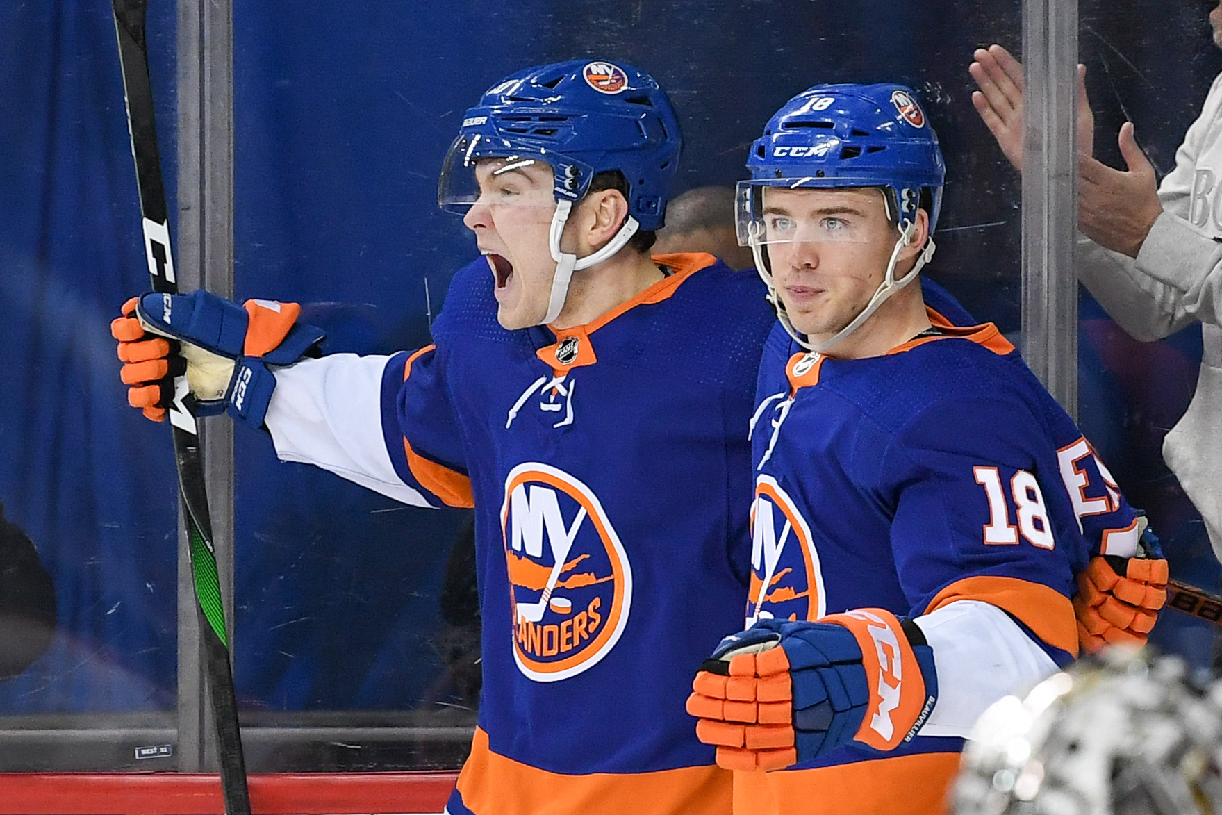 Feb 6, 2020; Brooklyn, New York, USA; New York Islanders left wing Kieffer Bellows (20) celebrates his first NHL goal with New York Islanders left wing Anthony Beauvillier (18) against the Los Angeles Kings during the second period at Barclays Center. Mandatory Credit: Dennis Schneidler-USA TODAY Sports