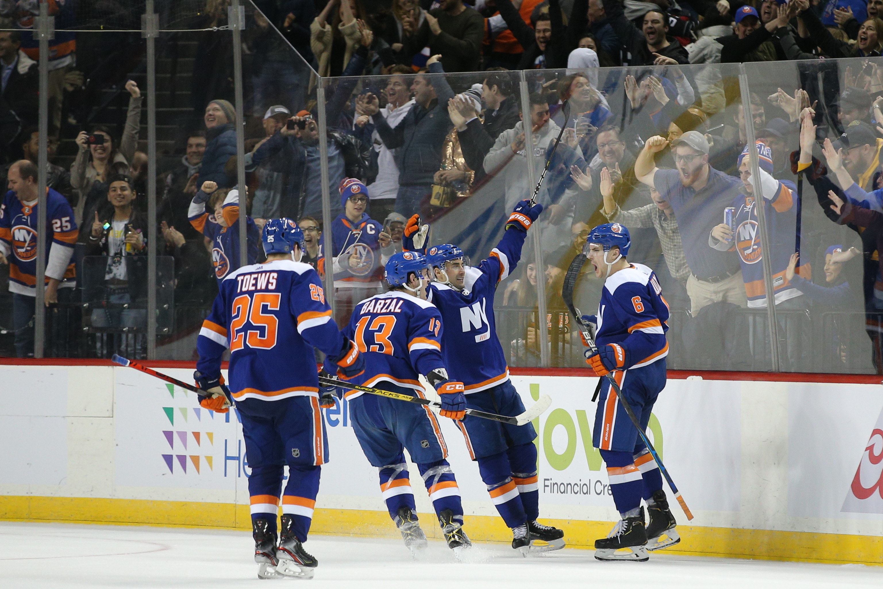 Feb 11, 2020; Brooklyn, New York, USA; New York Islanders defenseman Ryan Pulock (6) celebrates his game winning goal against the Philadelphia Flyers with teammates during the third period at Barclays Center. Mandatory Credit: Brad Penner-USA TODAY Sports
