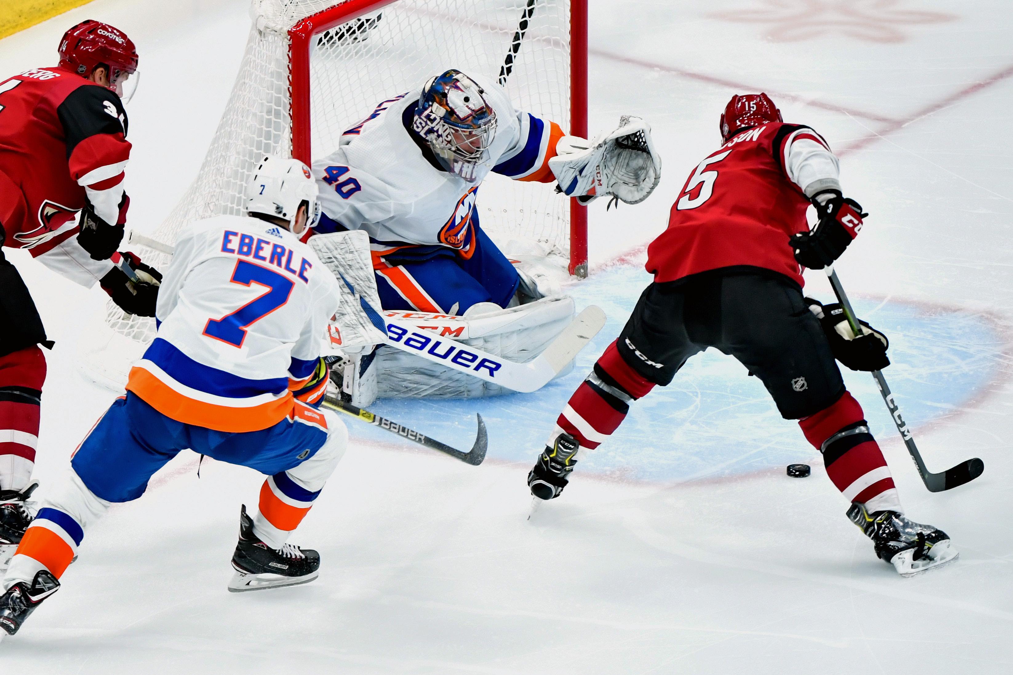 Feb 17, 2020; Glendale, Arizona, USA; Arizona Coyotes center Brad Richardson (15) shoots against New York Islanders goaltender Semyon Varlamov (40) during the second period at Gila River Arena. Mandatory Credit: Matt Kartozian-USA TODAY Sports