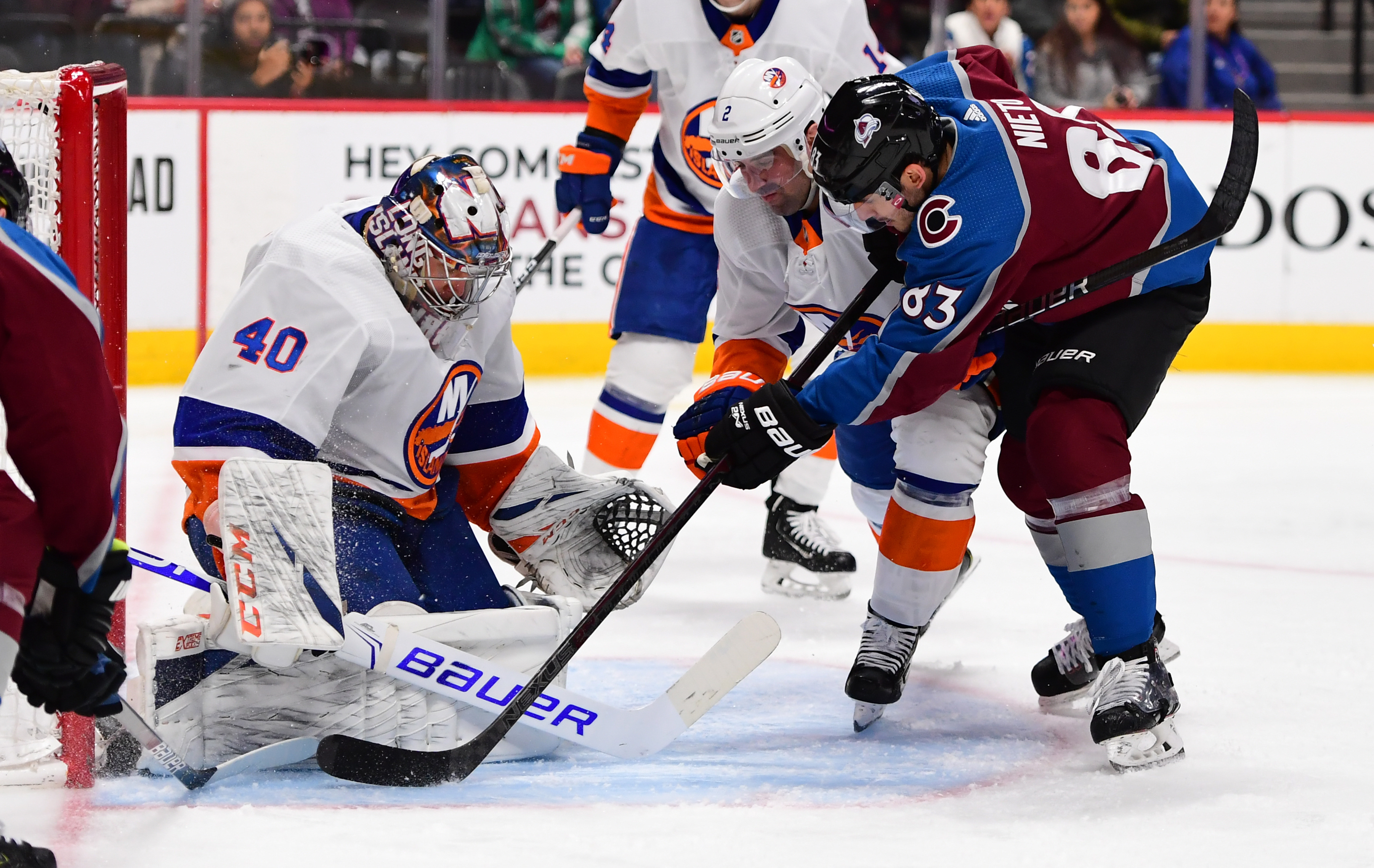 Feb 19, 2020; Denver, Colorado, USA; Colorado Avalanche left wing Matt Nieto (83) attempts to score past New York Islanders goaltender Semyon Varlamov (40) and defenseman Nick Leddy (2) in the second period at the Pepsi Center. Mandatory Credit: Ron Chenoy-USA TODAY Sports