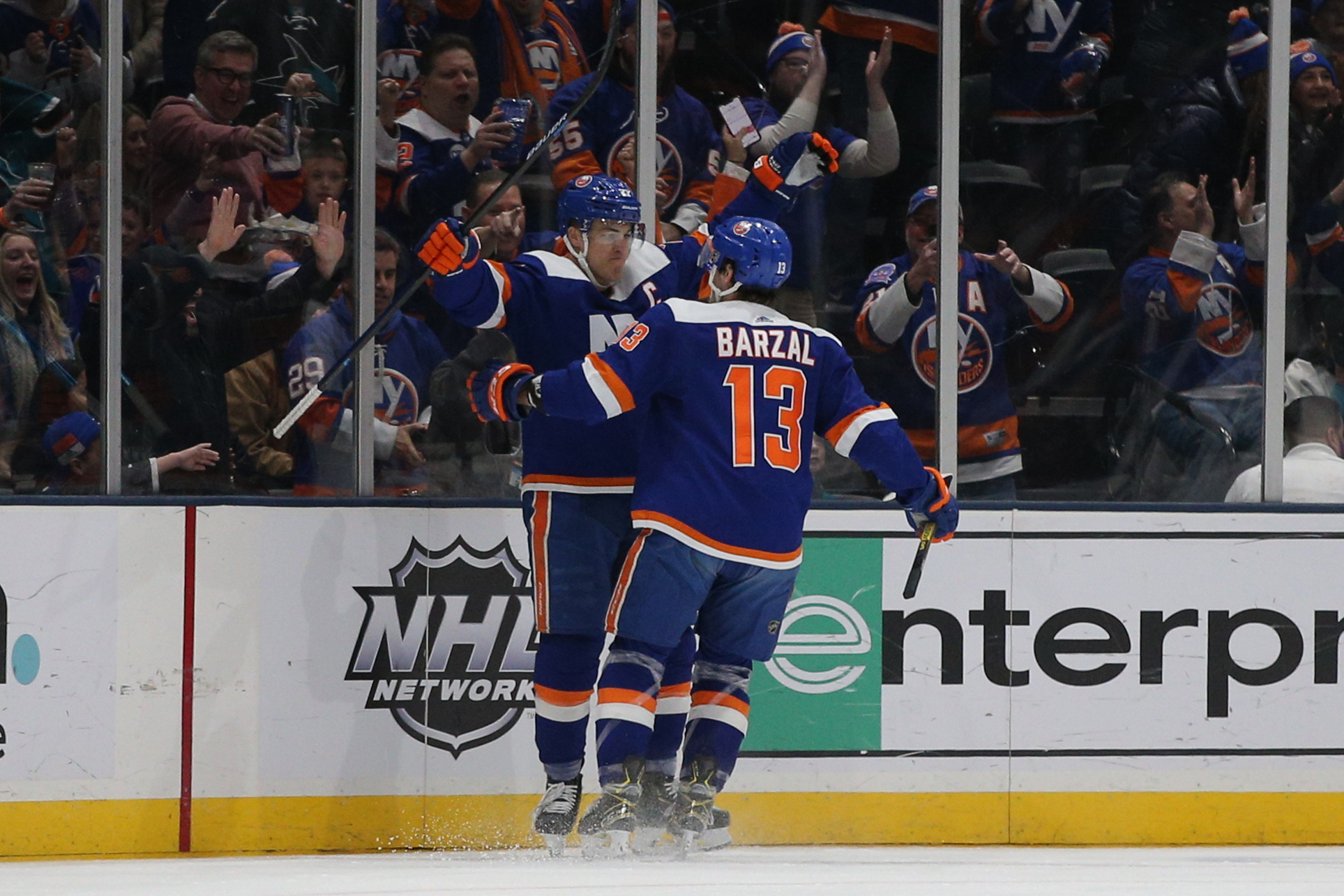 Feb 23, 2020; Uniondale, New York, USA; New York Islanders left wing Anders Lee (27) celebrates his goal against the San Jose Sharks with center Mathew Barzal (13) during the first period at Nassau Veterans Memorial Coliseum. Mandatory Credit: Brad Penner-USA TODAY Sports