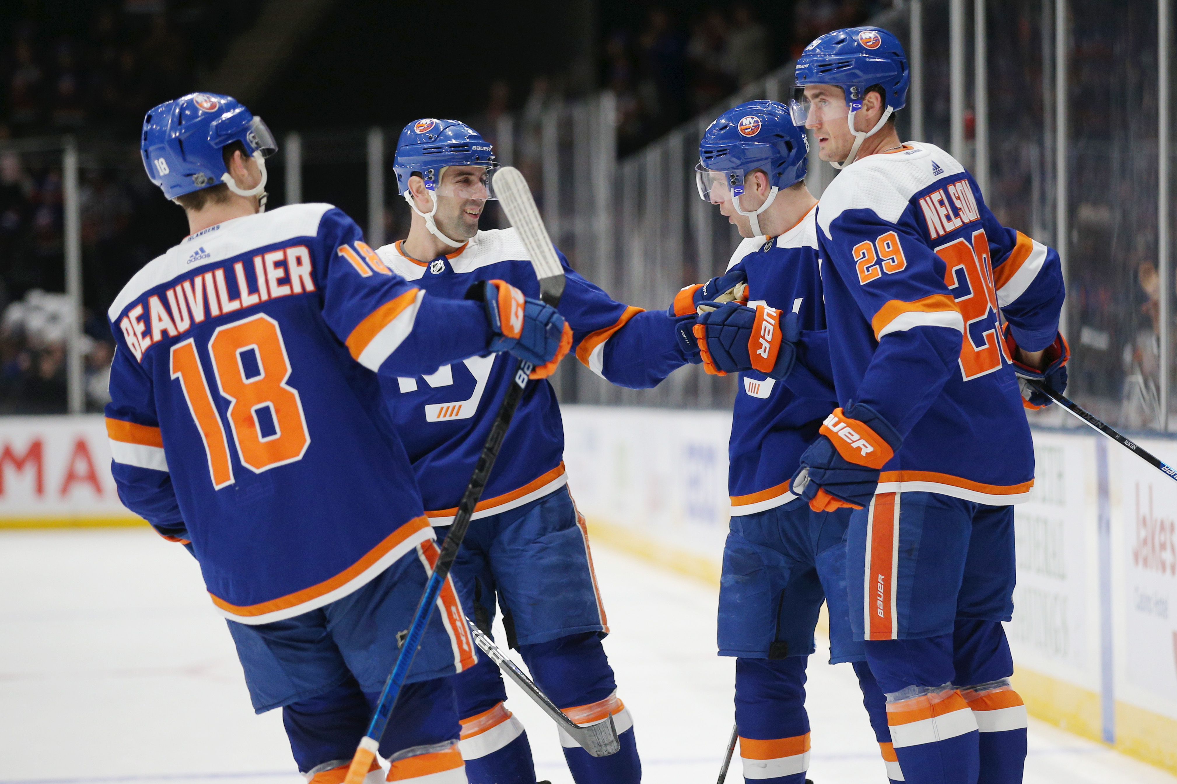 Feb 23, 2020; Uniondale, New York, USA; New York Islanders defenseman Devon Toews (25) celebrates his goal against the San Jose Sharks with teammates during the second period at Nassau Veterans Memorial Coliseum. Mandatory Credit: Brad Penner-USA TODAY Sports