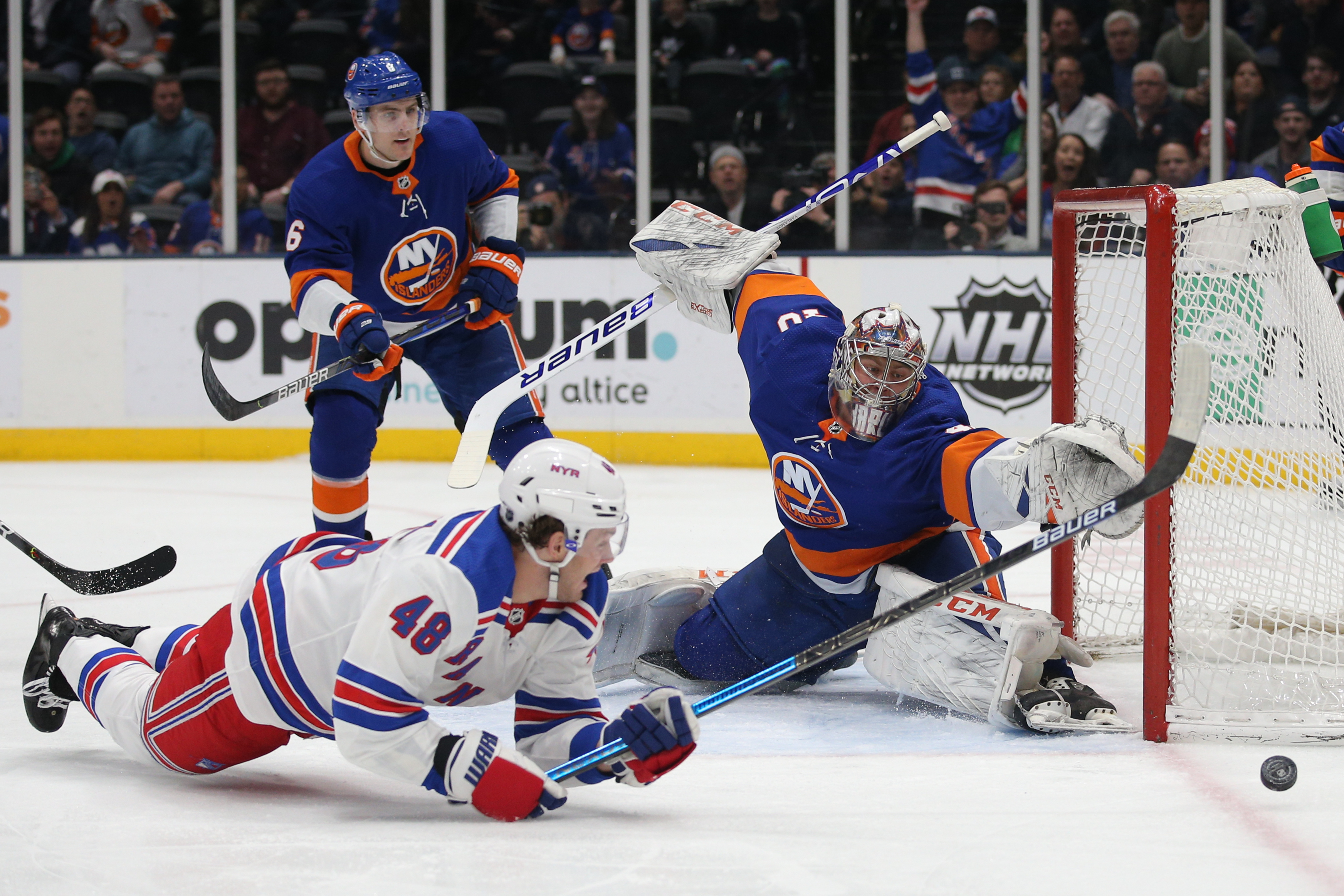 Feb 25, 2020; Uniondale, New York, USA; New York Islanders goalie Semyon Varlamov (40) makes a save on a shot by New York Rangers left wing Brendan Lemieux (48) during the first period at Barclays Center. Mandatory Credit: Brad Penner-USA TODAY Sports