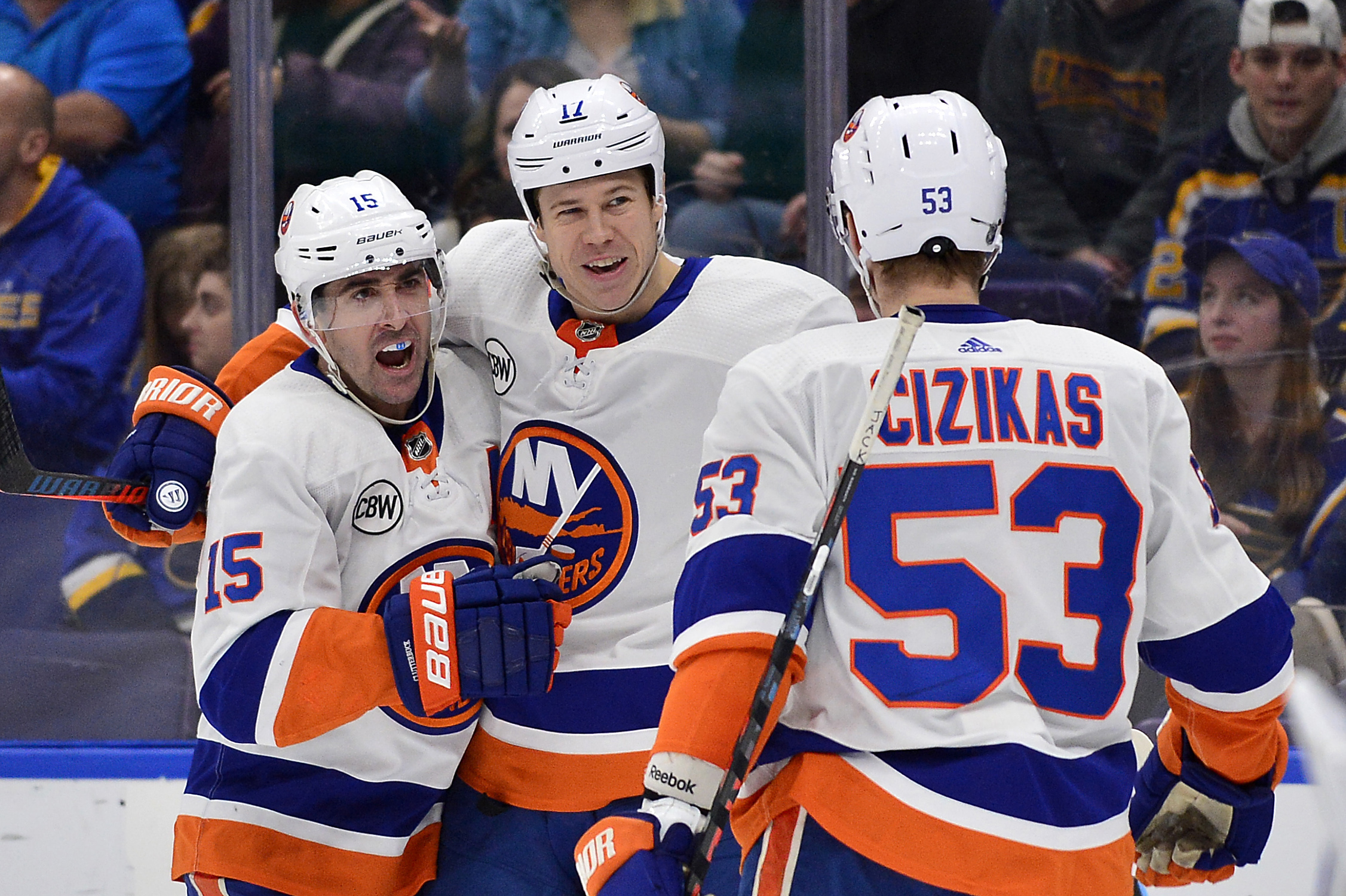 Jan 5, 2019; St. Louis, MO, USA; New York Islanders left wing Matt Martin (17) is congratulated by right wing Cal Clutterbuck (15) and center Casey Cizikas (53) after scoring during the second period against the St. Louis Blues at Enterprise Center. Mandatory Credit: Jeff Curry-USA TODAY Sports