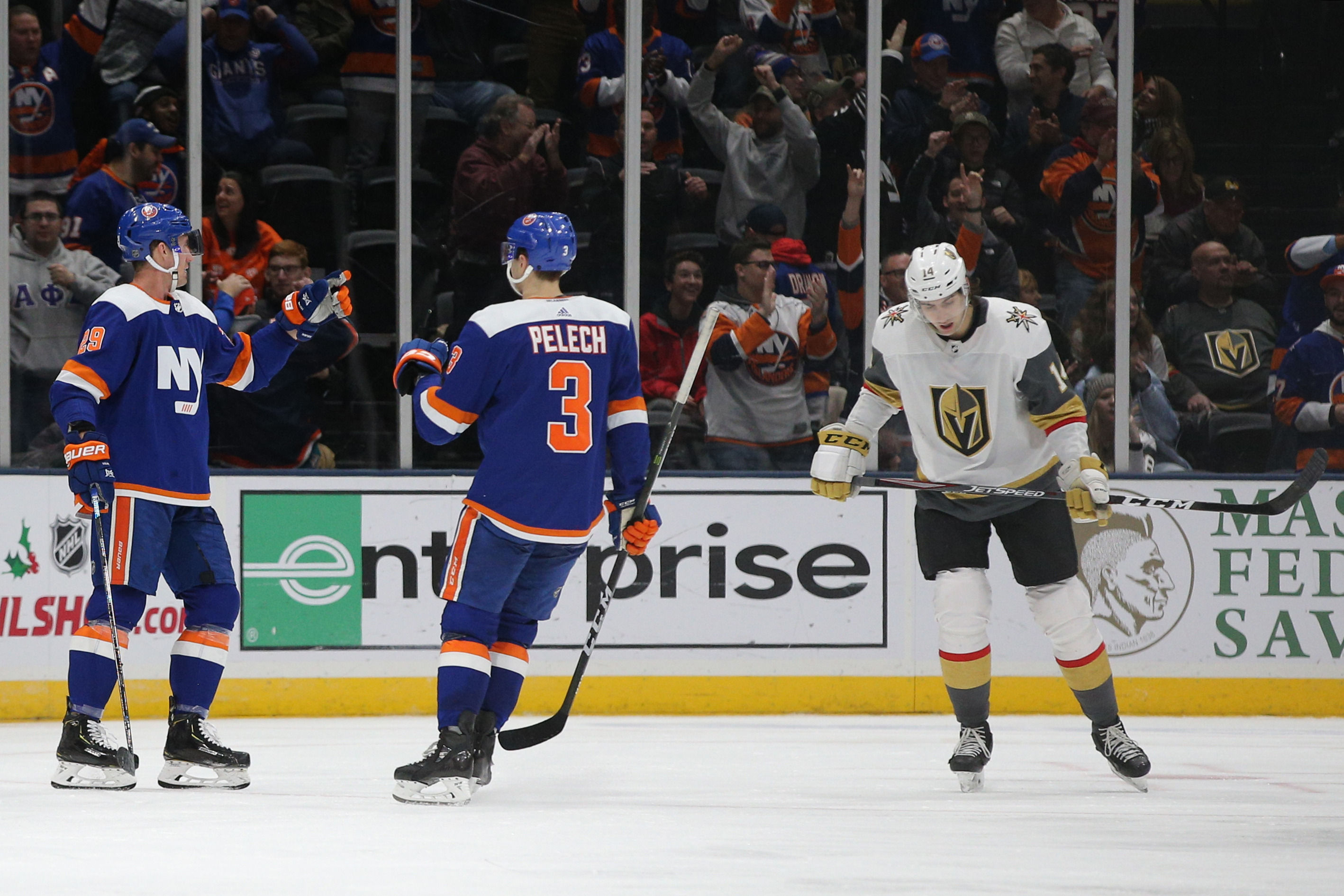 Dec 5, 2019; Uniondale, NY, USA; New York Islanders center Brock Nelson (29) celebrates with defenseman Adam Pelech (3) after scoring a goal against the Vegas Golden Knights in front of Golden Knights defenseman Nicolas Hague (14) during the third period at Nassau Veterans Memorial Coliseum. Mandatory Credit: Brad Penner-USA TODAY Sports