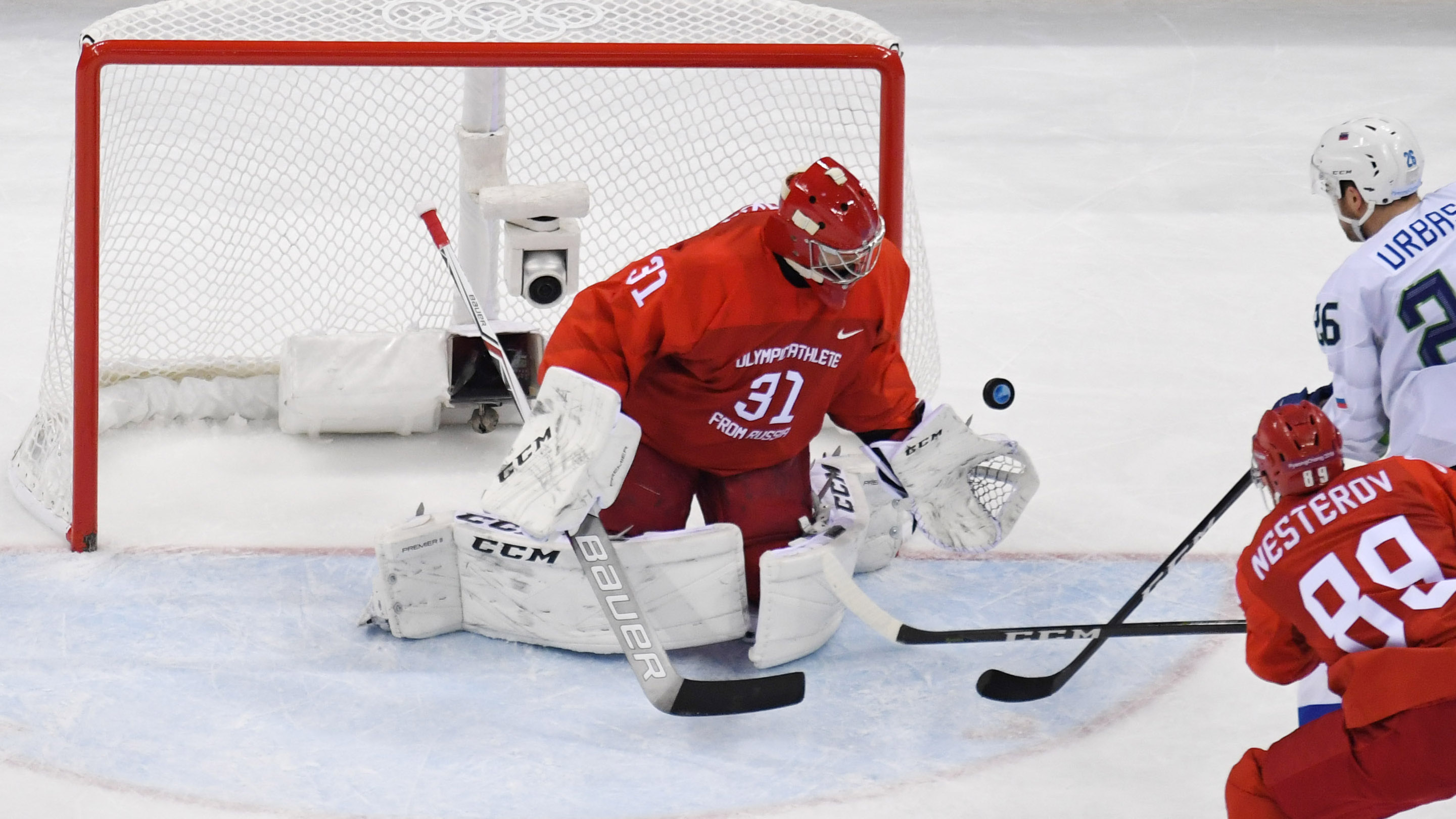 Feb 16, 2018; Gangneung, South Korea; Olympic Athlete of Russia goalkeeper Ilya Sorokin (31) makes a save from a shot by Slovenia forward Jan Urbas (26) during the third period at the Pyeongchang 2018 Olympic Winter Games at Gangneung Hockey Centre. Mandatory Credit: David E. Klutho-USA TODAY Sports