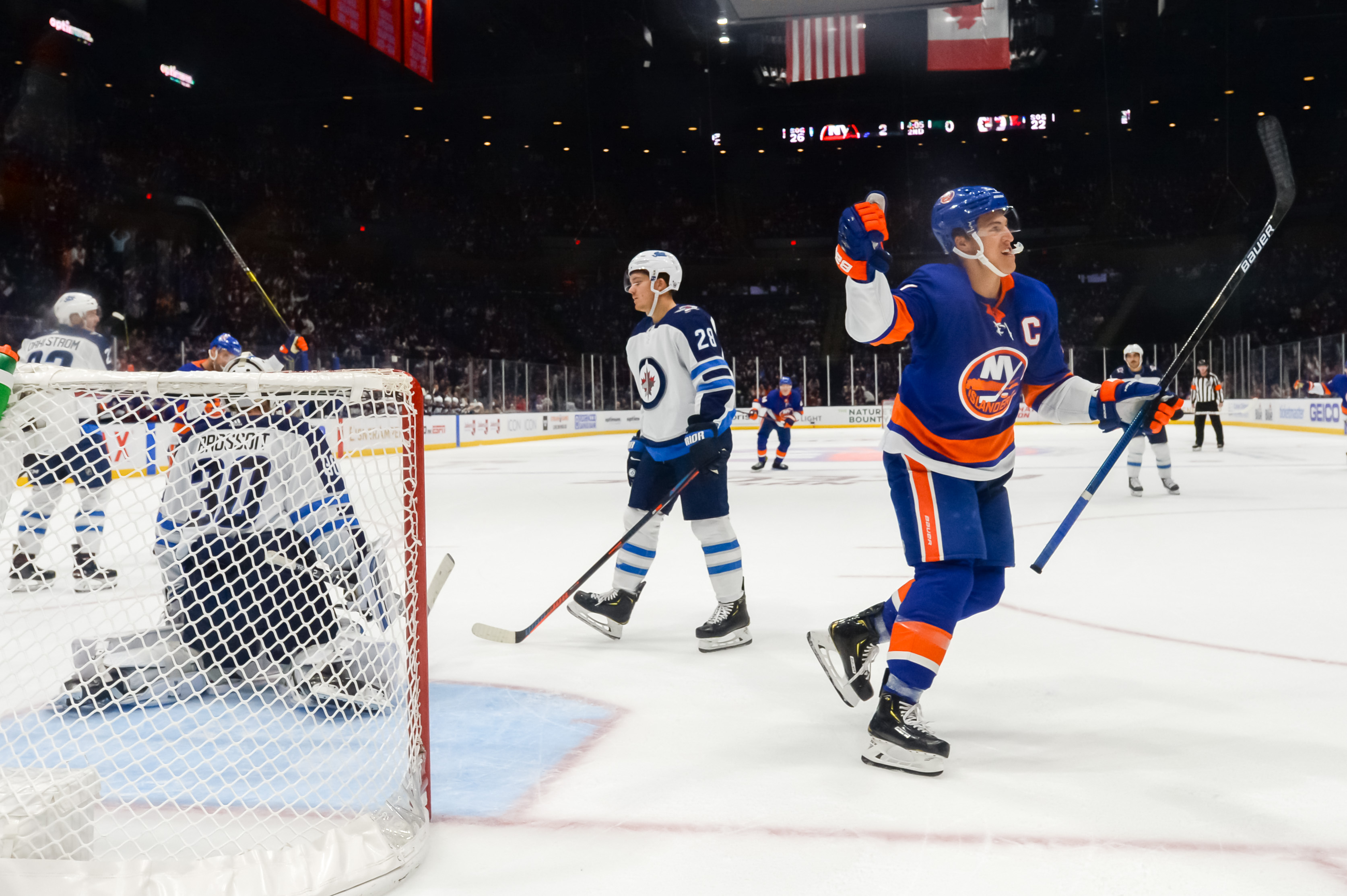 Oct 6, 2019; Brooklyn, NY, USA; New York Islanders left wing Anders Lee (27) celebrates his goal against the Winnipeg Jets during the second period at Nassau Veterans Memorial Coliseum. Mandatory Credit: Dennis Schneidler-USA TODAY Sports
