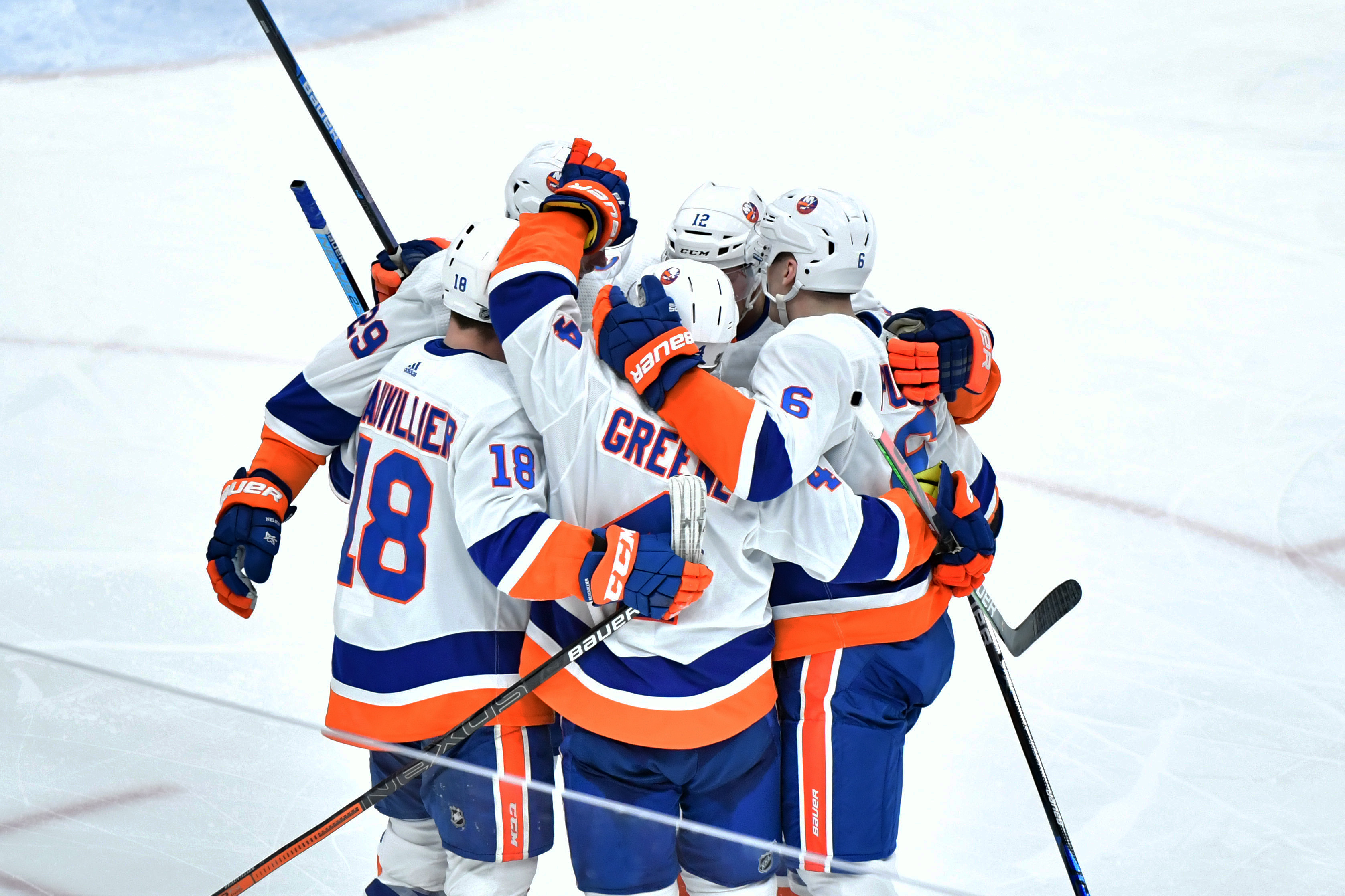 Feb 17, 2020; Glendale, Arizona, USA; New York Islanders left wing Anthony Beauvillier (18) celebrates with teammates after scoring a goal against the Arizona Coyotes in the third period at Gila River Arena. Mandatory Credit: Matt Kartozian-USA TODAY Sports